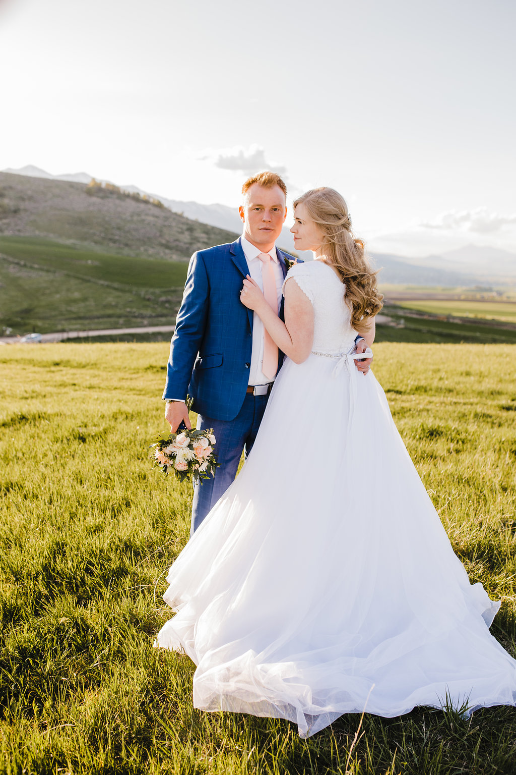 casual natural posing navy blue suit bride and groom in love romantic mountain adventurous couple wedding photography in cache valley utah