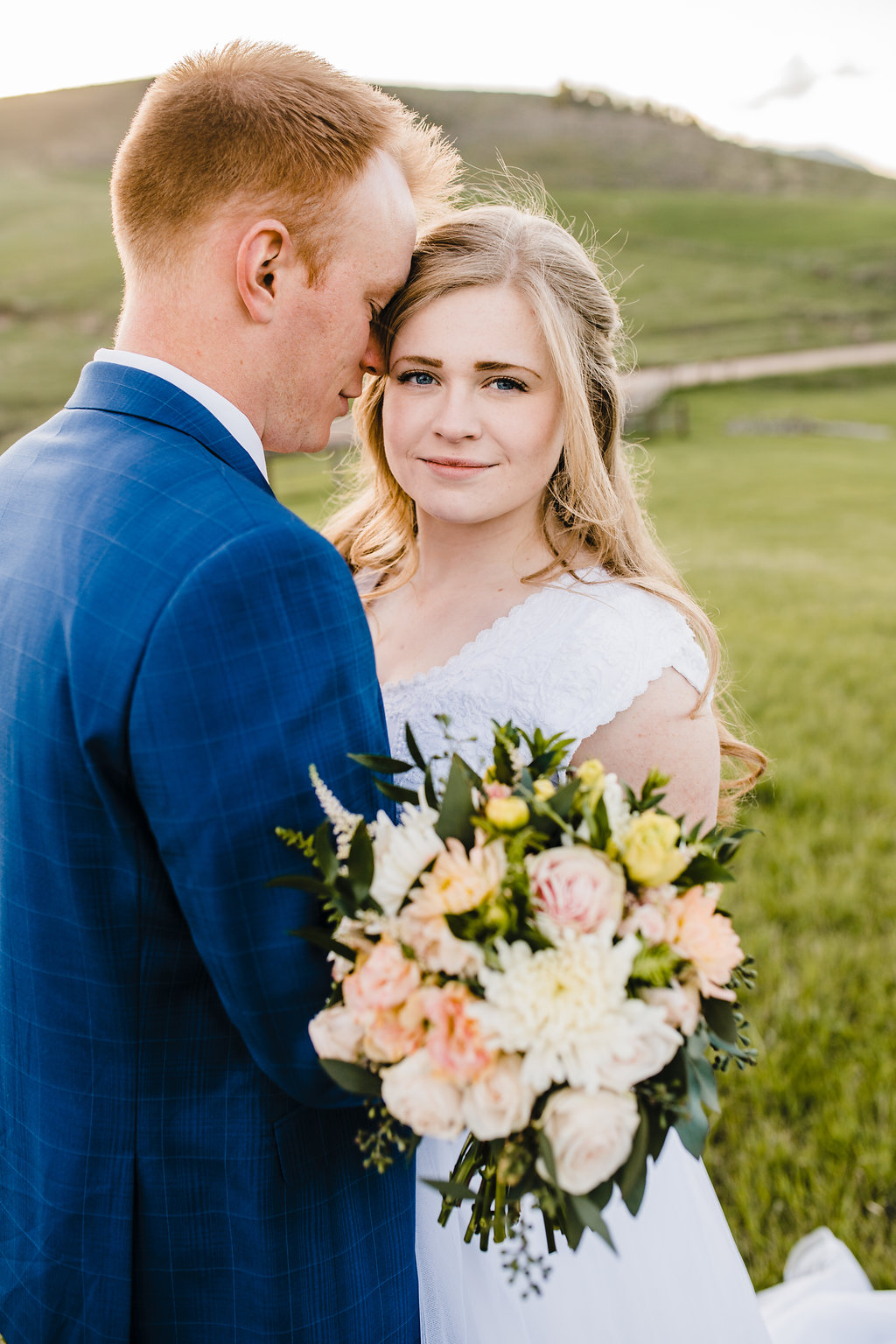 northern utah bright colors wedding photography outdoors wedding photo shoot bride and groom formals photography peach and yellow bridal bouquet wedding florals navy blue suit