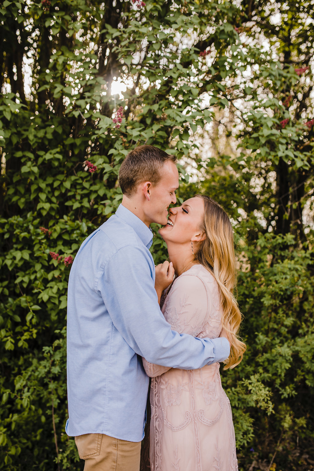 cute couple professional engagement pictures in logan utah calli richards shooting at an orchard in paradise