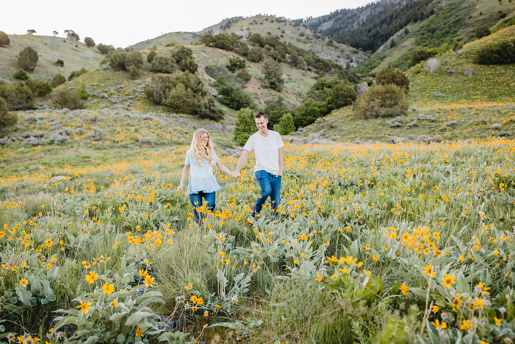 northern utah engagement photographer calli richards adventurous couples field of flowers mountainous engagement