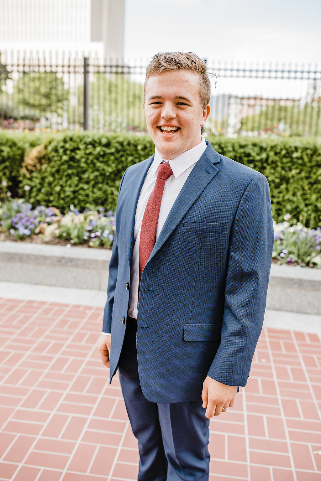 formal groom photo before the first look at the salt lake city lds temple navy blue wedding suit