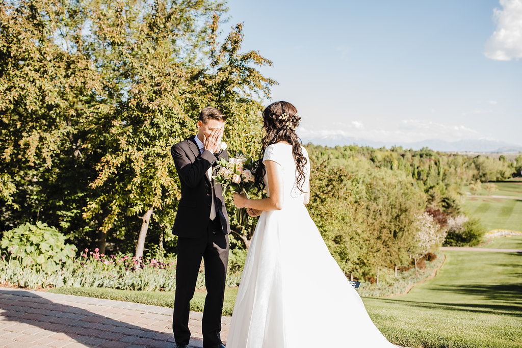 professional wedding photos wedding day photographer in salt lake city utah first look surprised groom lds young couple