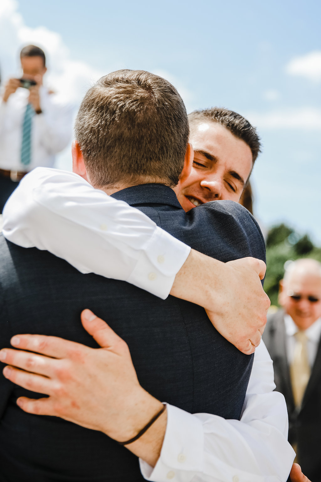 best professional wedding photographer in brigham city utah lds temple groom embrace wedding day photography
