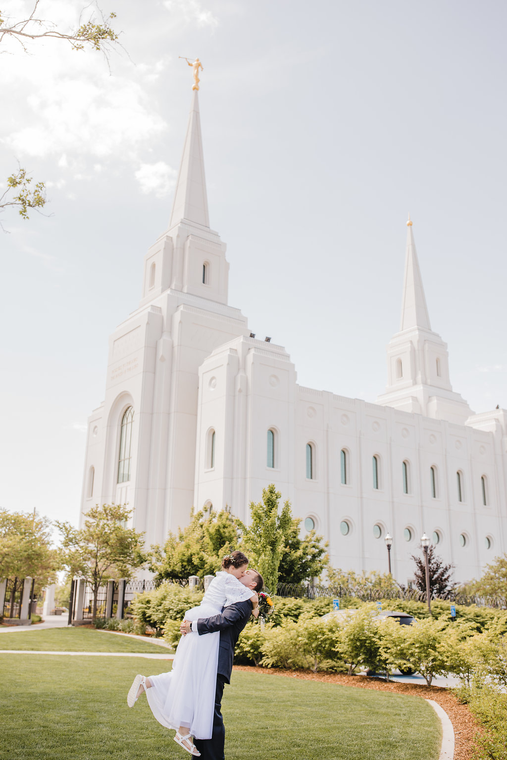 professional wedding day photos at the brigham city lds temple young couple romantic dancing on their wedding day calli richards