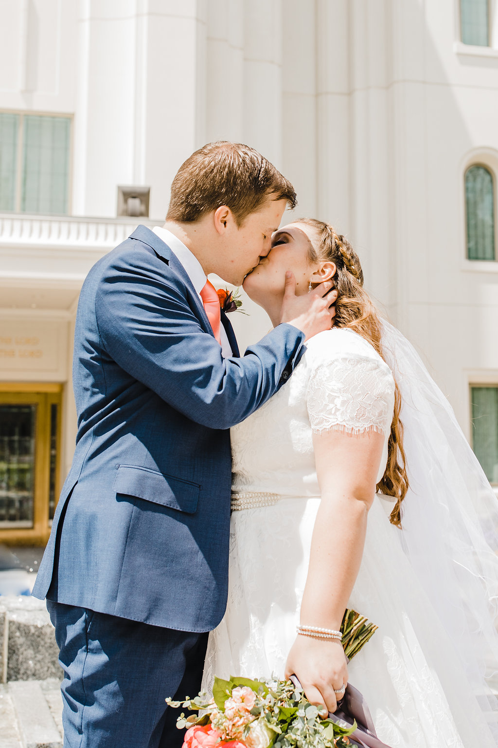 kiss after temple exit brigham city lds temple professional wedding day photographer in brigham city utah calli richards