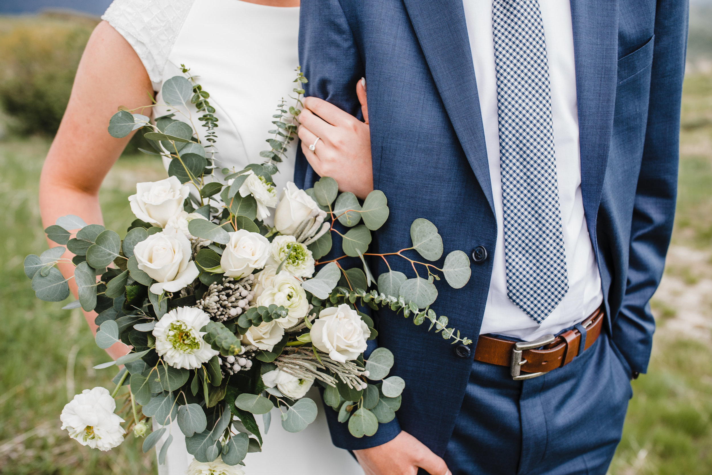 professional wedding photographer in boulder co captures all the details of your wedding day navy suit bouquet