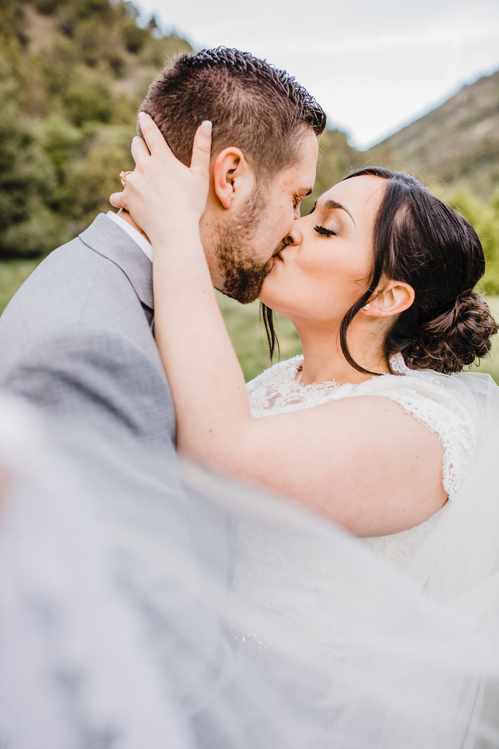 bride and groom kiss professional wedding photography