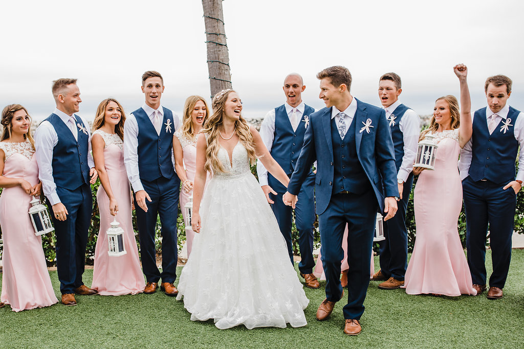 los angeles wedding party bridesmaids and groomsmen celebrating with bride and groom california wedding photographer