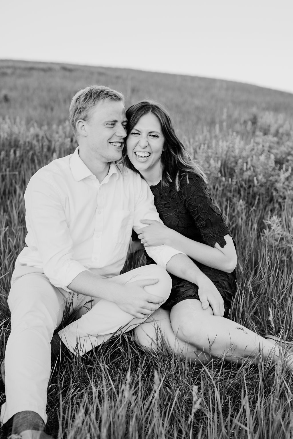 black and white professional engagement photography northern utah wedding photographer calli richards couple in field