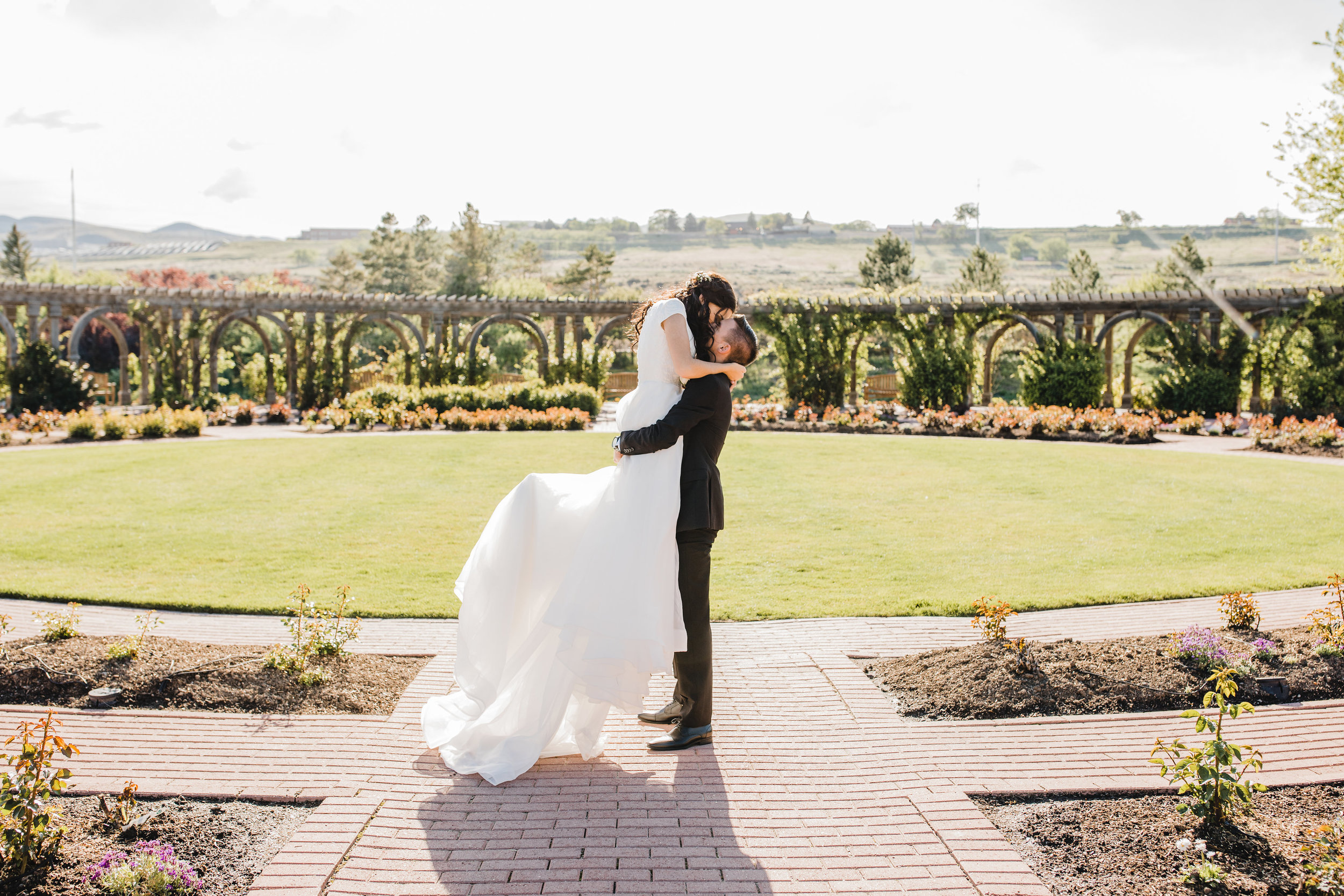 best wedding photographer in westminister colorado wedding arches garden photos kissing popped foot