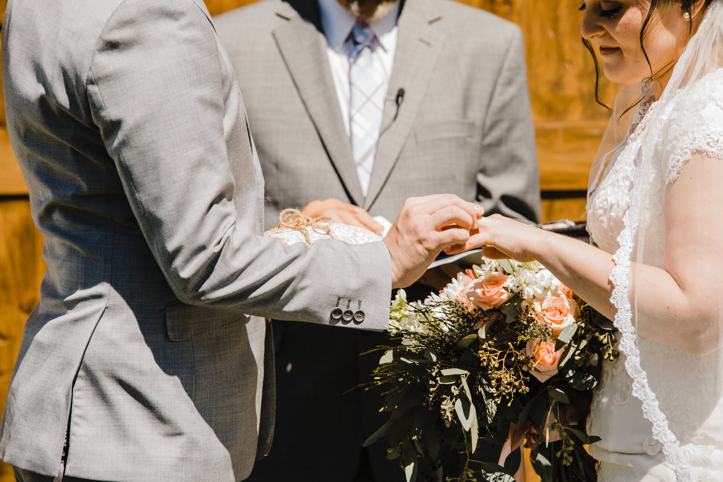 best wedding photographer in westminister colorado outdoor barn wedding ceremony rings vows