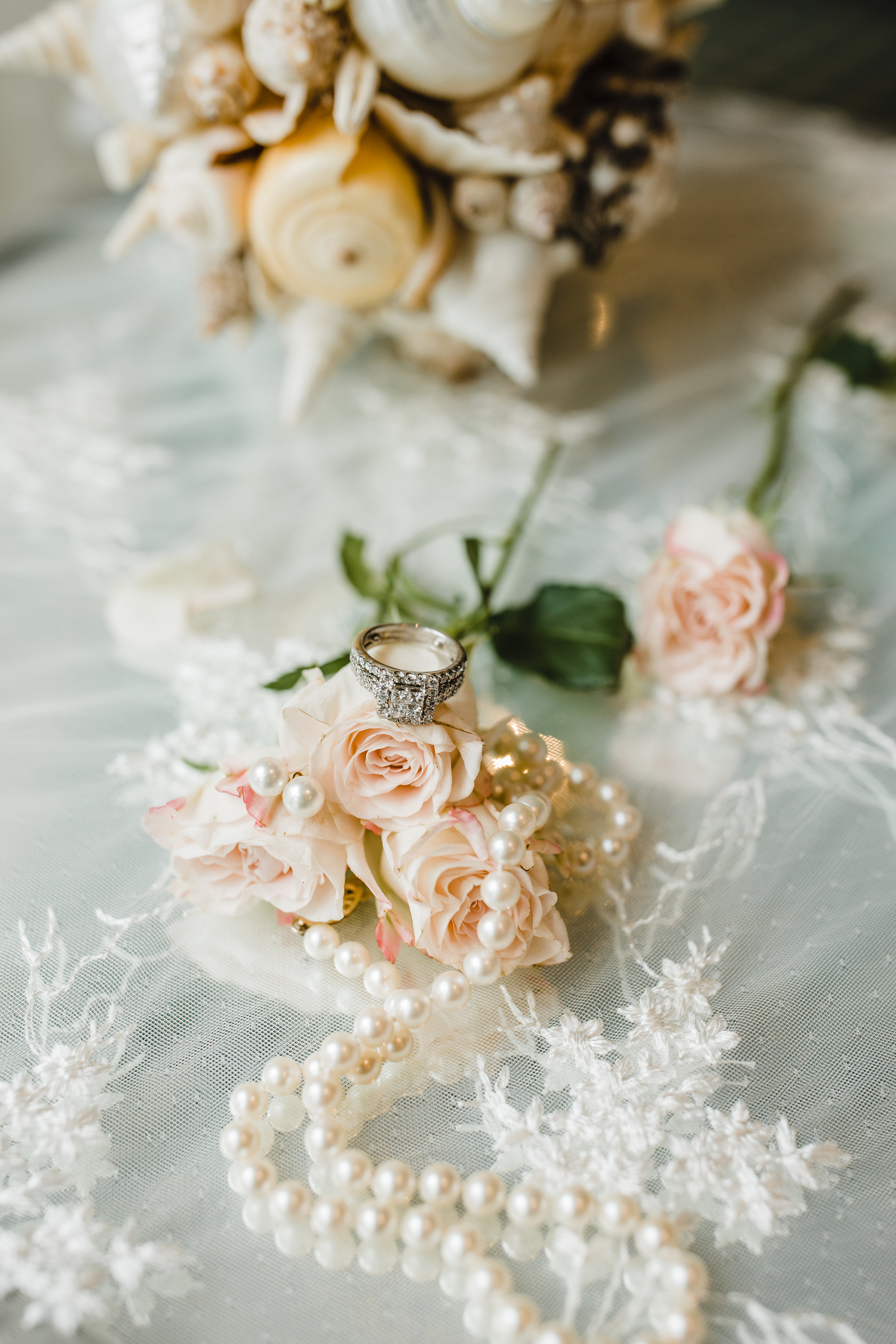 utah valley wedding photographer wedding details pink roses pearl necklace delicate lace wedding ring