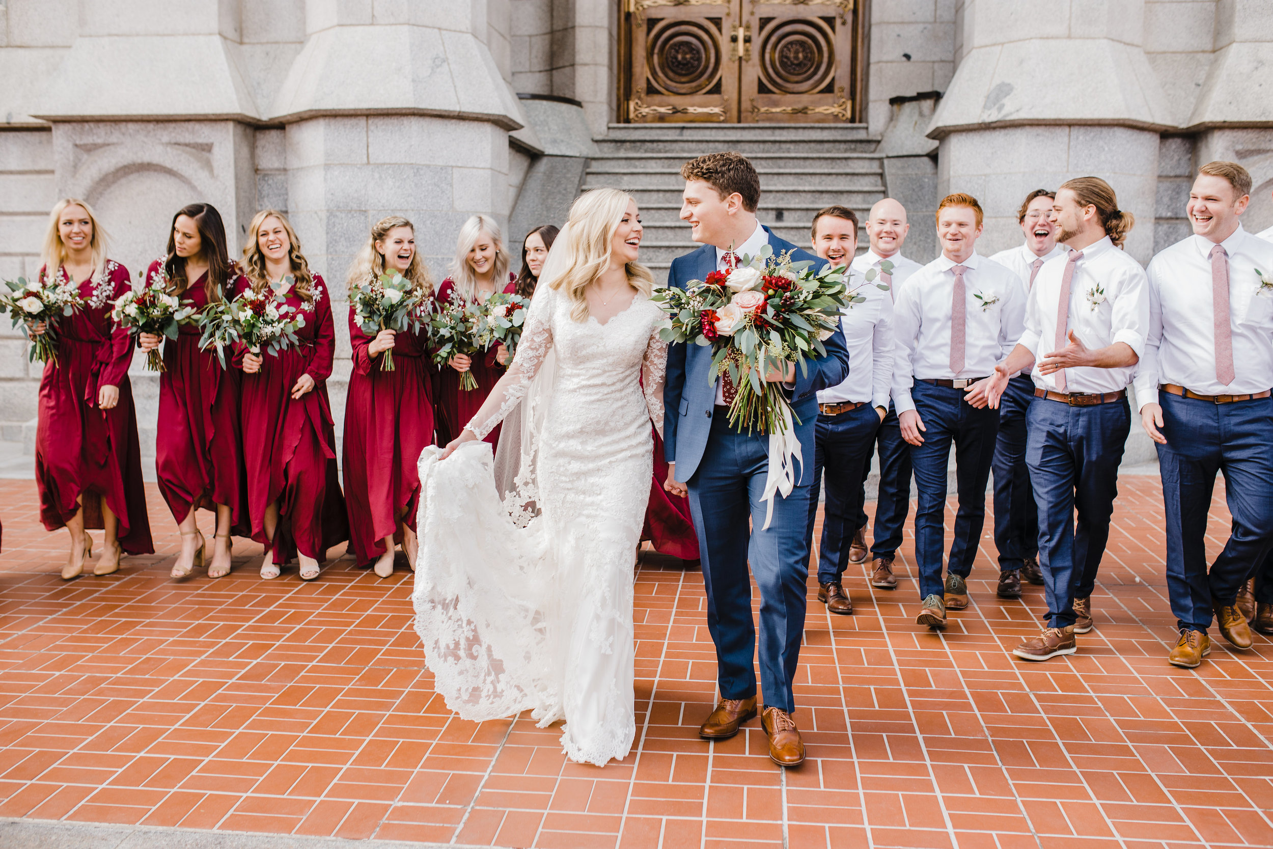 best professional wedding photographer in provo utah red bridesmaids dresses wedding exit holding hands laughter bohemian wedding bouquets nude heels