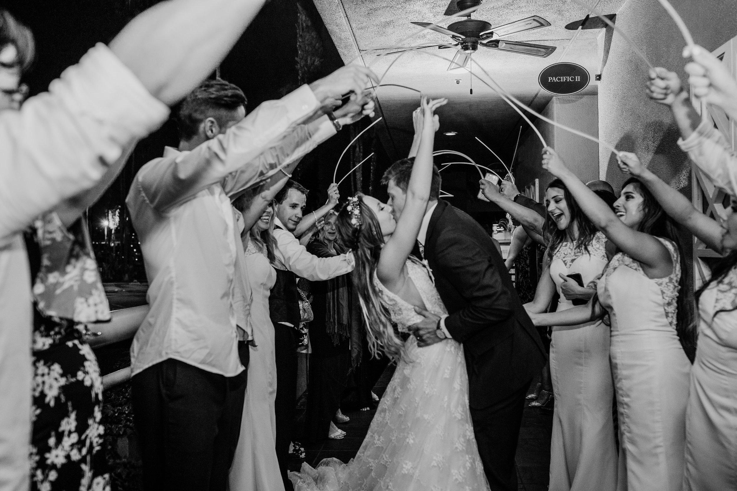 best professional wedding photographer in park city utah golw stick reception exit kissing romantic getaway car