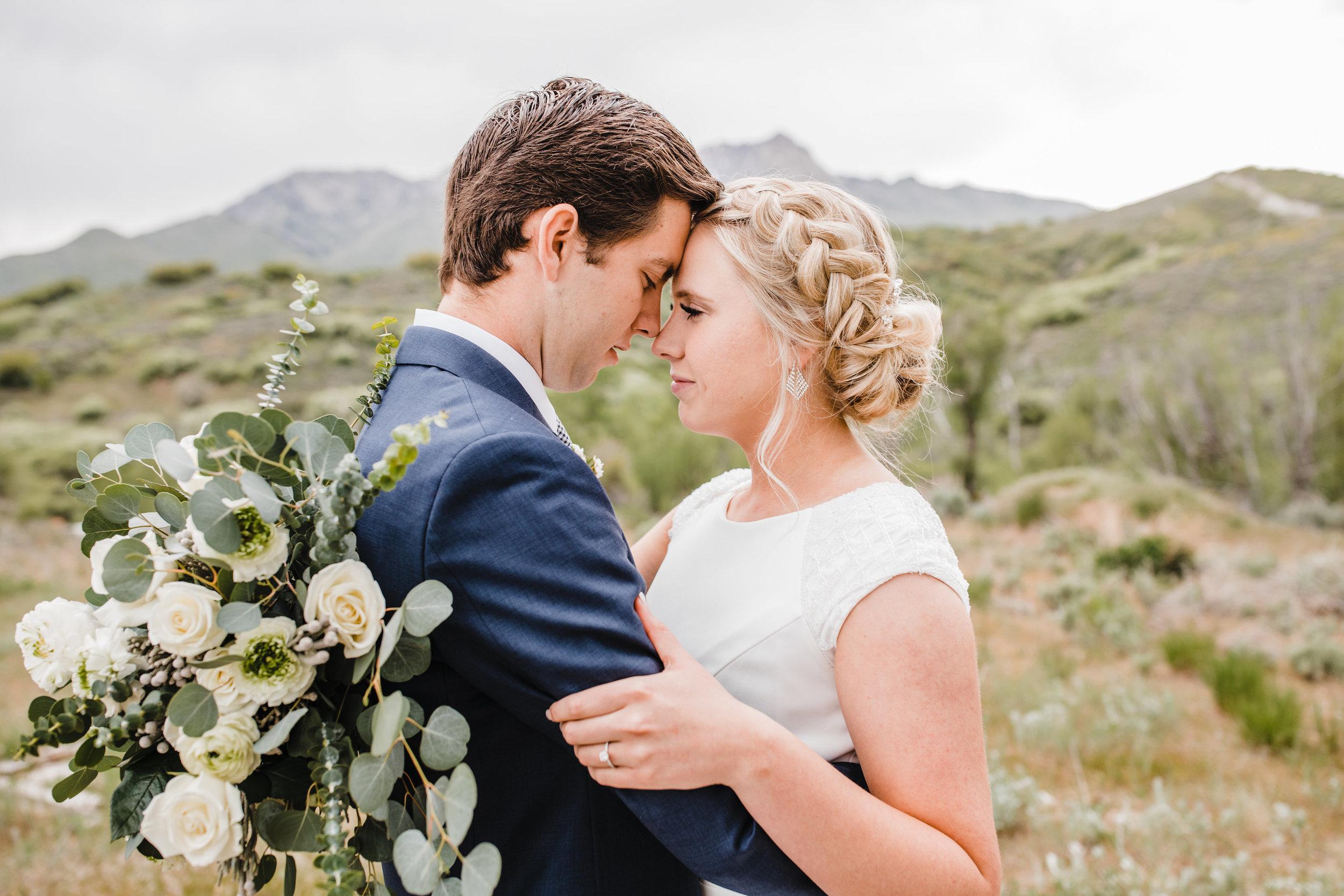 professional wedding photographer in park city utah mountain background modest wedding dress wedding hair bohemian flower bouquet