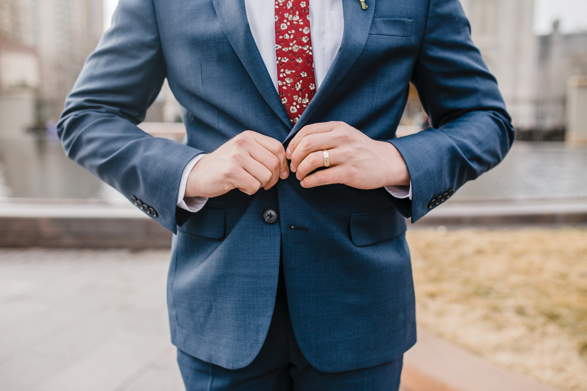 professional wedding photographer in logan utah gold wedding band suit jacket red tie