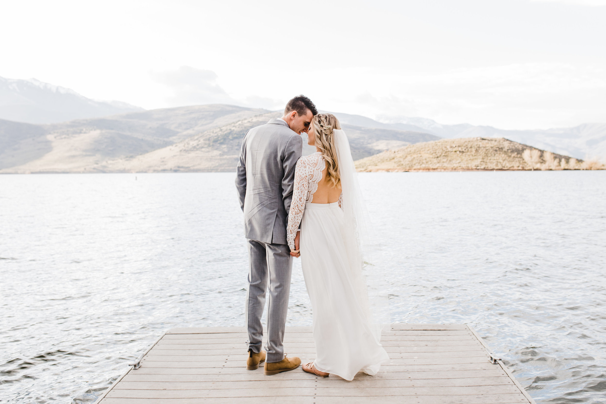 professional wedding photographer in cache valley utah lake bridals mountains holding hands