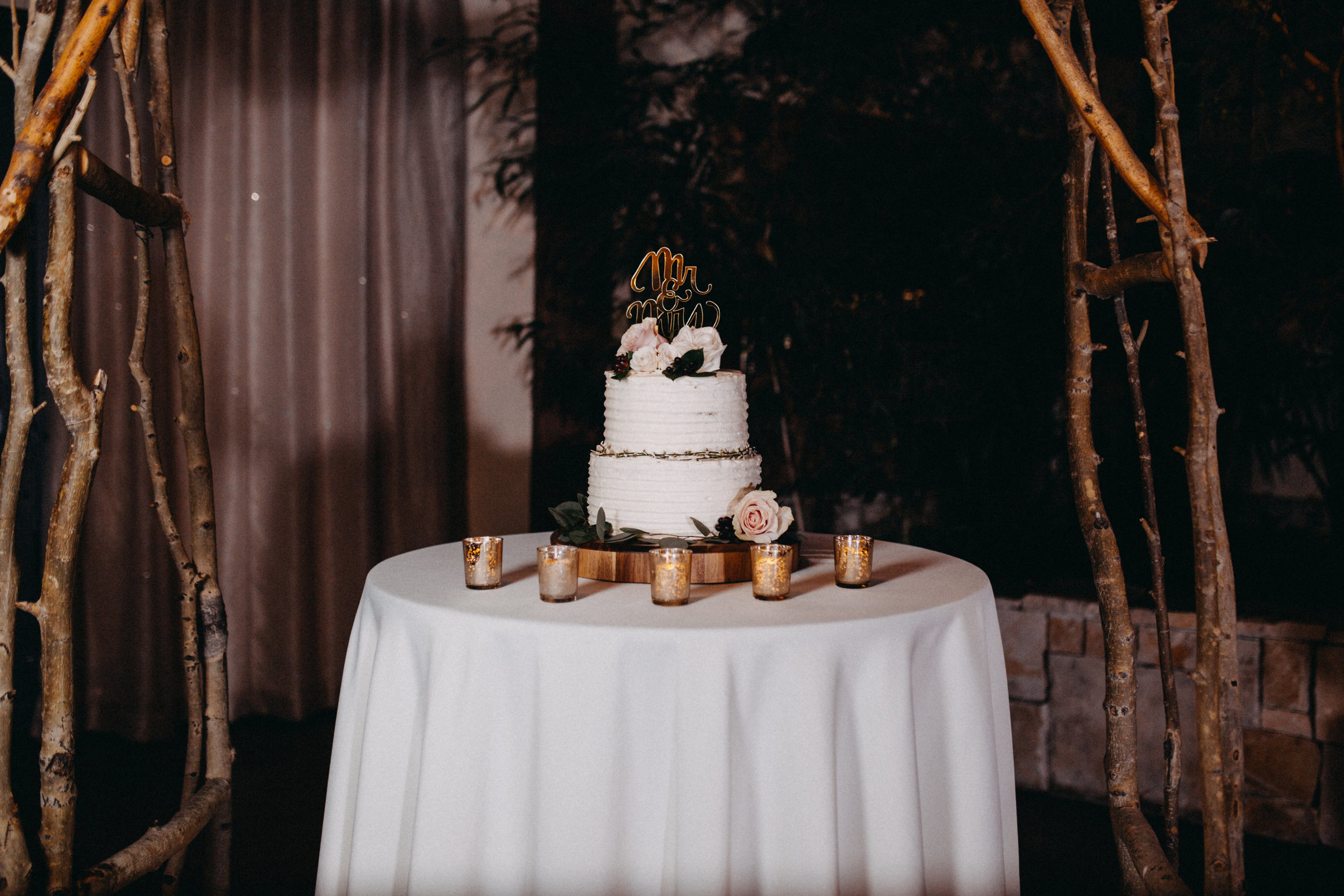 wedding photographer in lakewood colorado tiered wedding cake mr and mrs tea lights rustic wedding reception