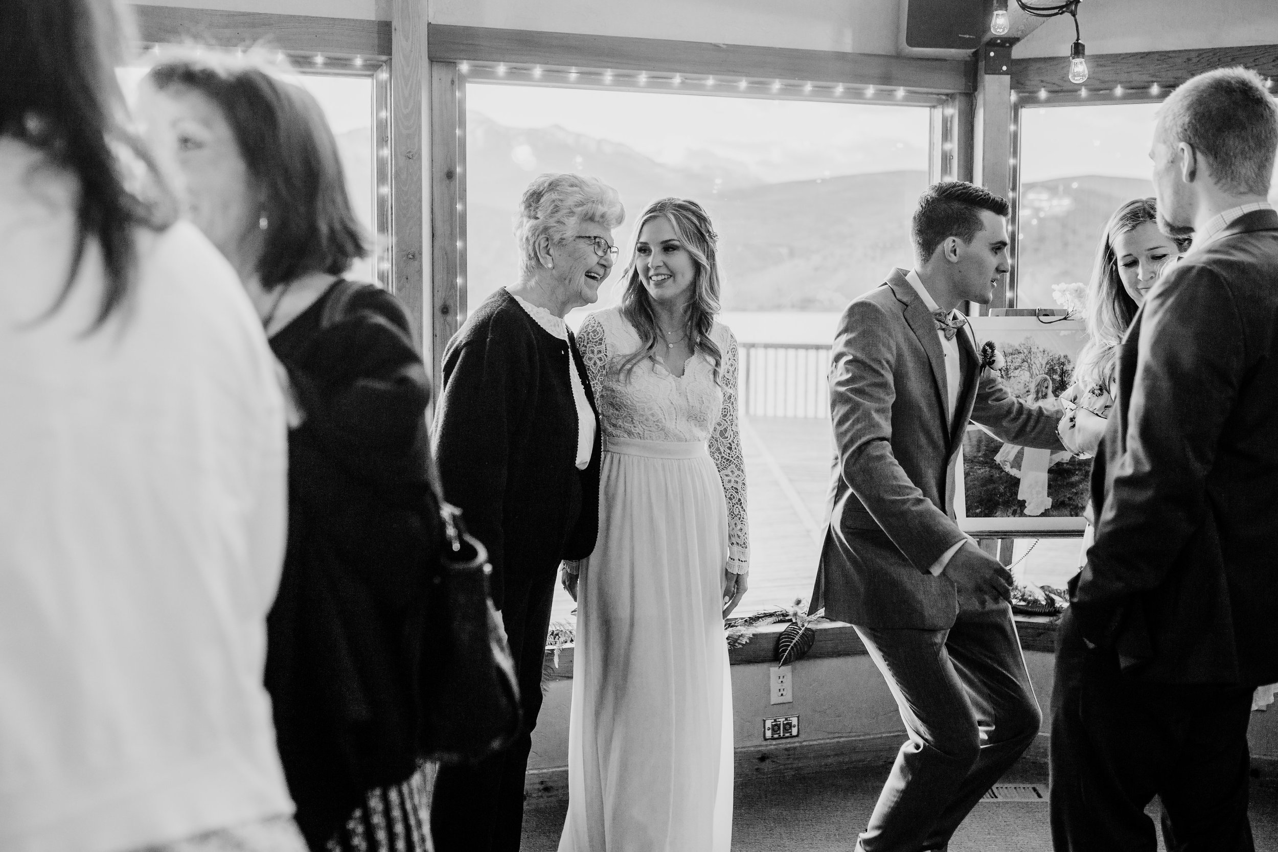 best wedding photographer in lakewood colorado wedding reception family guests smiling
