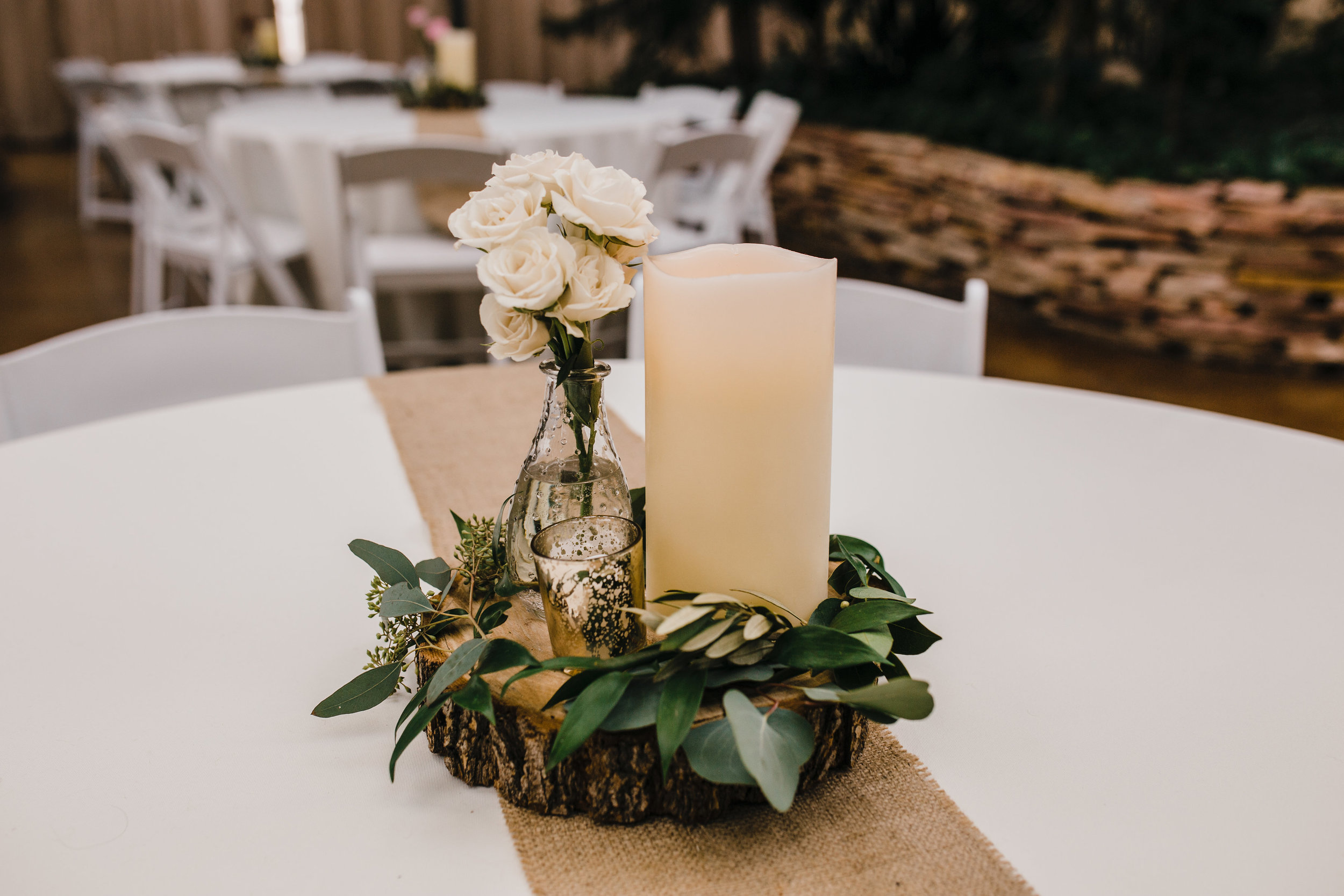 best wedding photographer in lakewood colorado rustic wedding reception tea lights simple greenery
