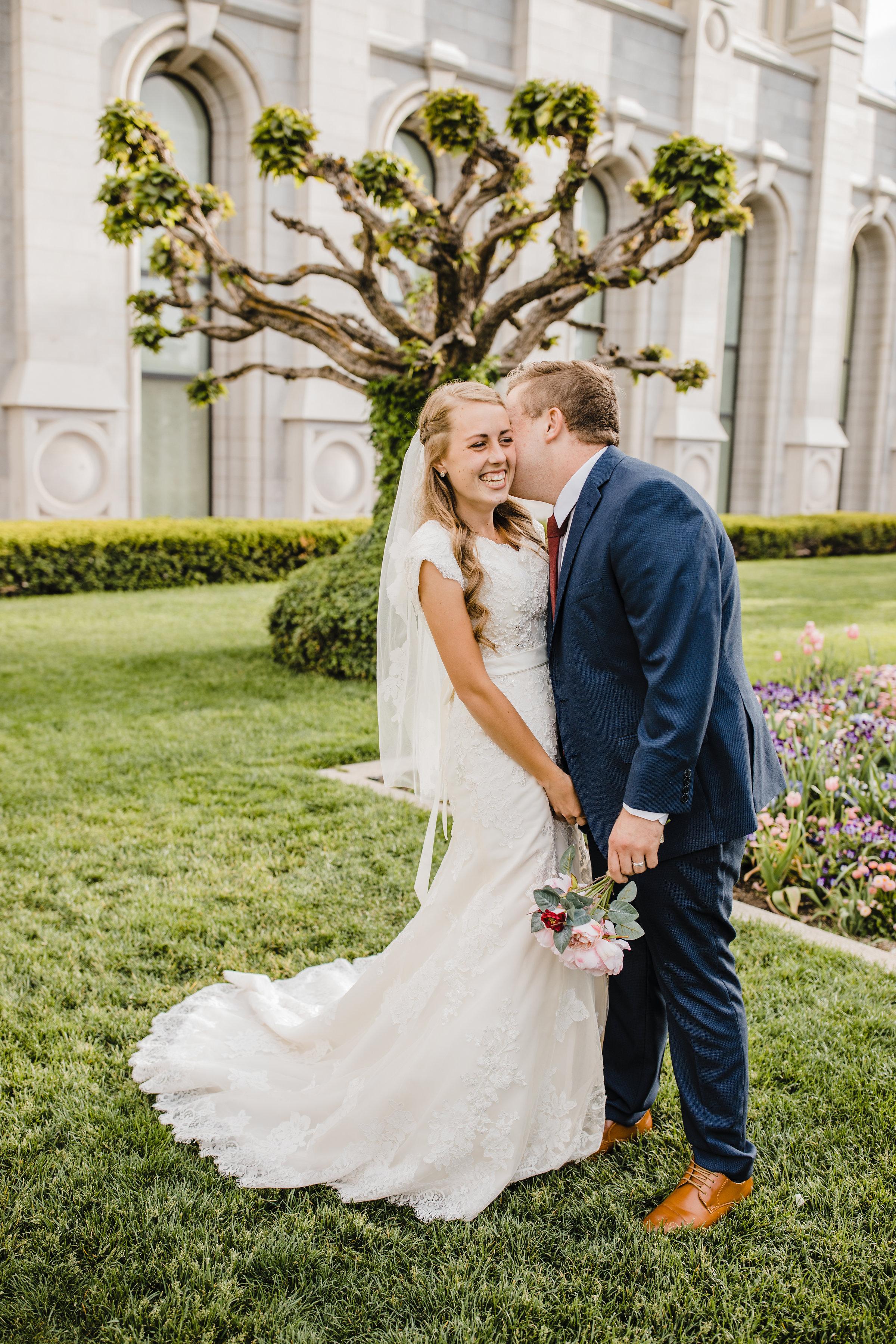 professional wedding photographer in lakewood colorado lds temple wedding salt lake wedding photographer kissing temple grounds
