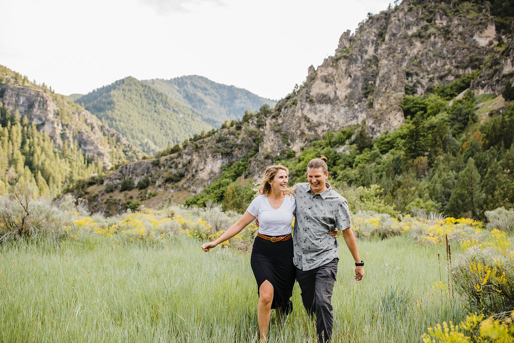 Mountainside engagement pictures northern utah professional wedding photographer calli richards couple laughing walking