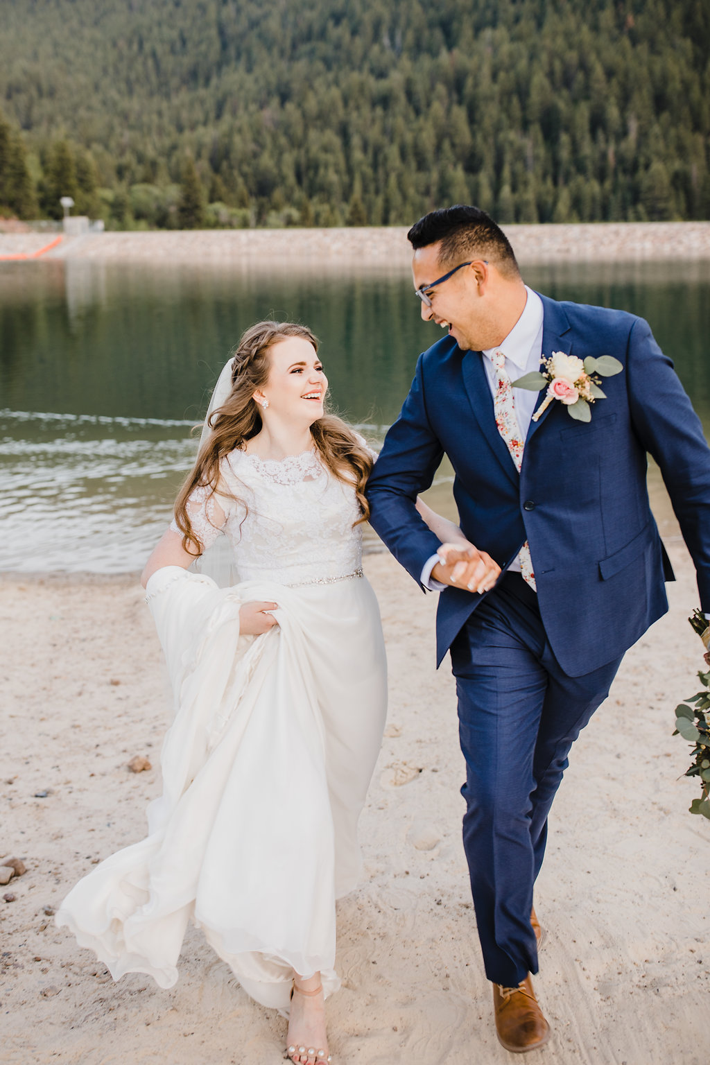 bride and groom by the water provo utah tibble fork reservoir northern utah wedding photographer calli richards