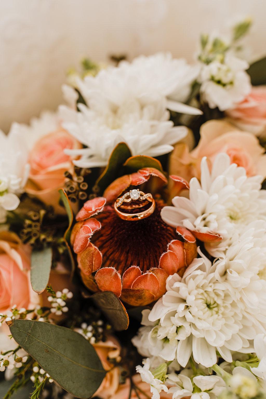 bouquet ring shot wedding day detail photography orange flowers rose gold