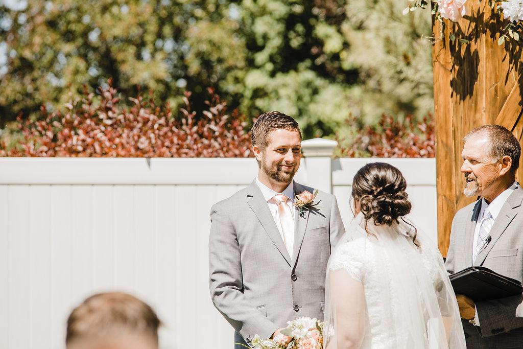 groom facial expression wedding ceremony monroe utah professional wedding day photographer calli richards