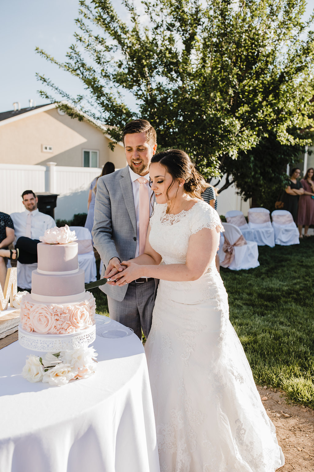 bride and groom cutting the wedding cake lace and roses wedding cake central utah wedding photographer calli richards
