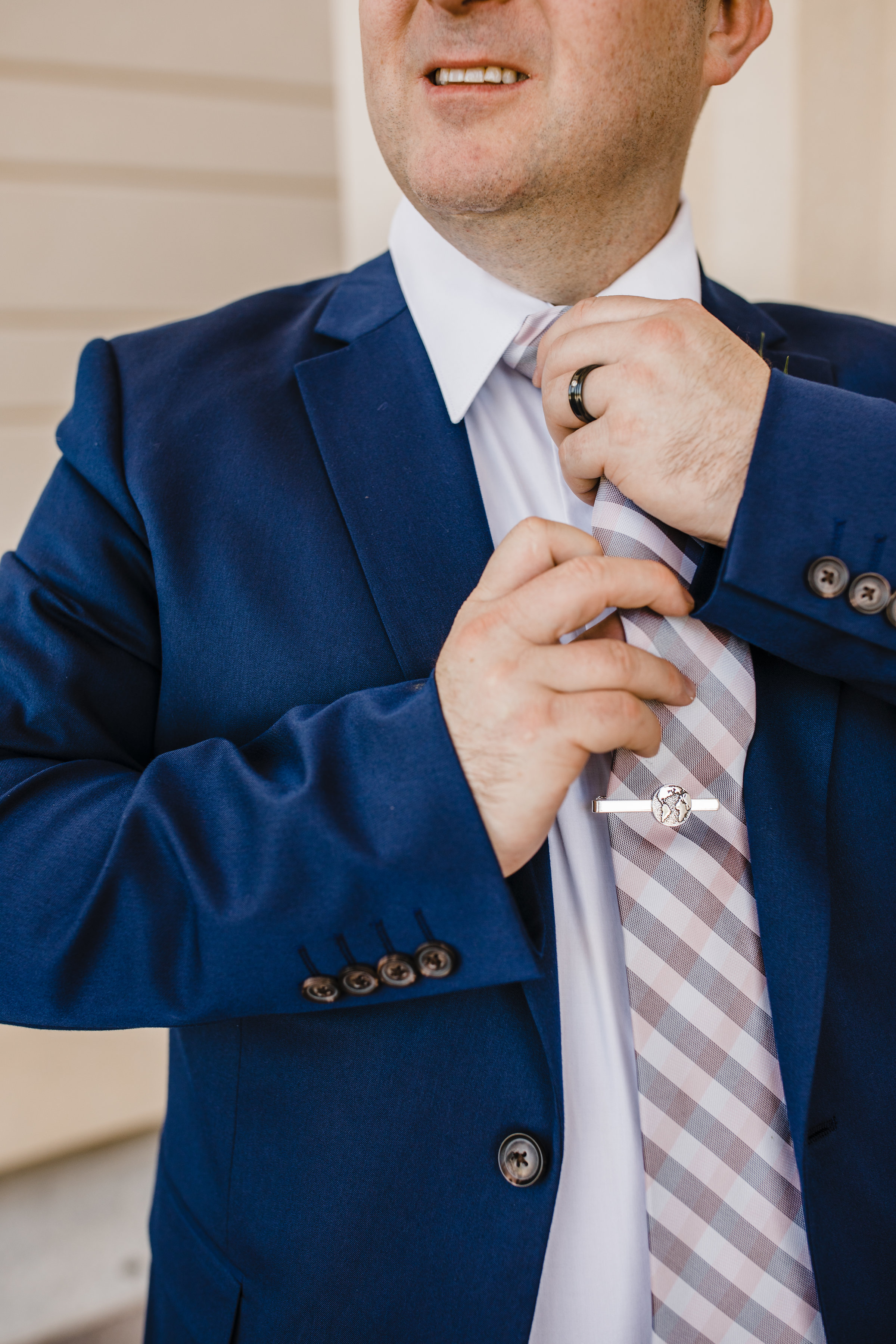 professional wedding photographer in cache valley groom tie navy suit jacket