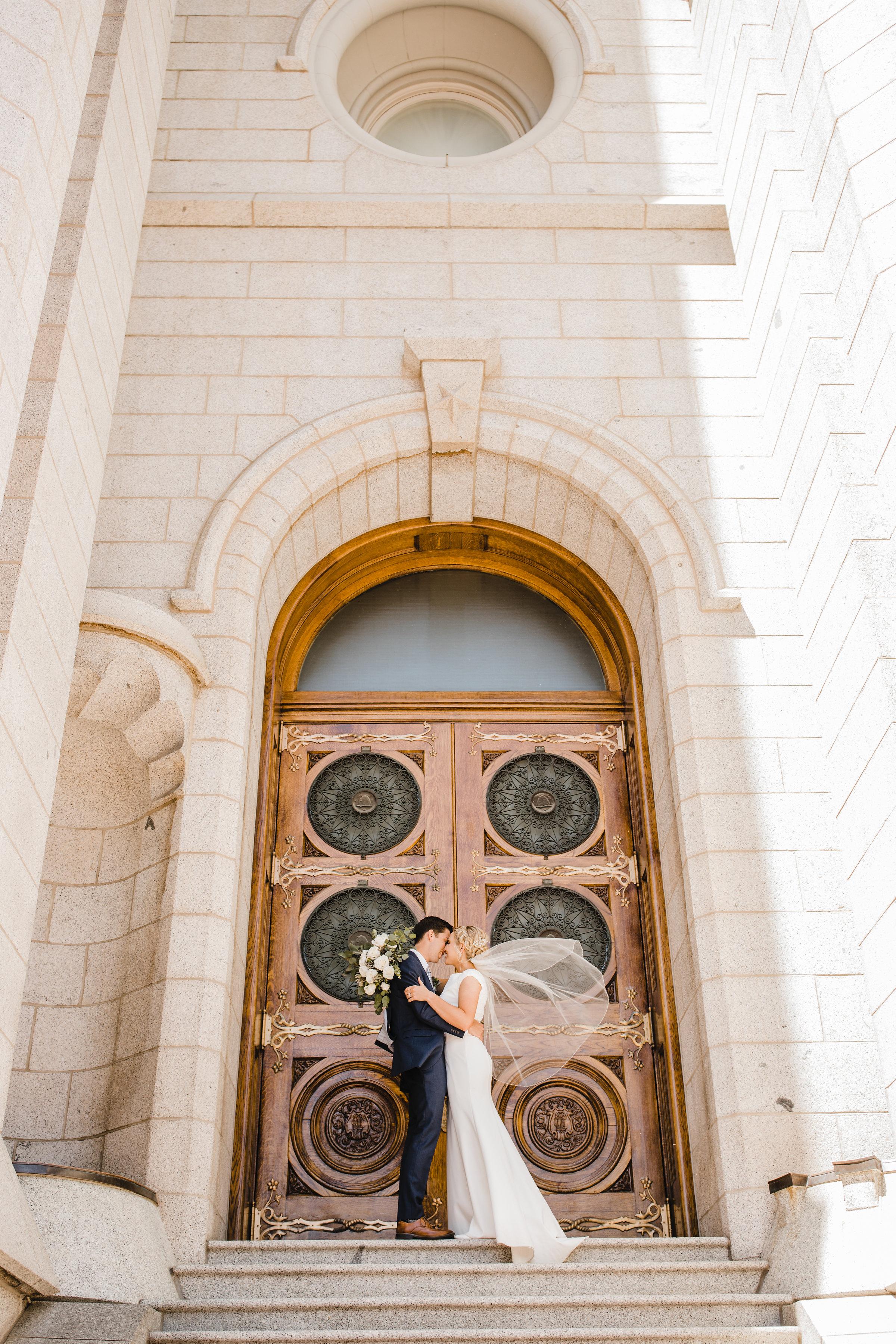 professional wedding photographer salt lake city utah kissing lds temple