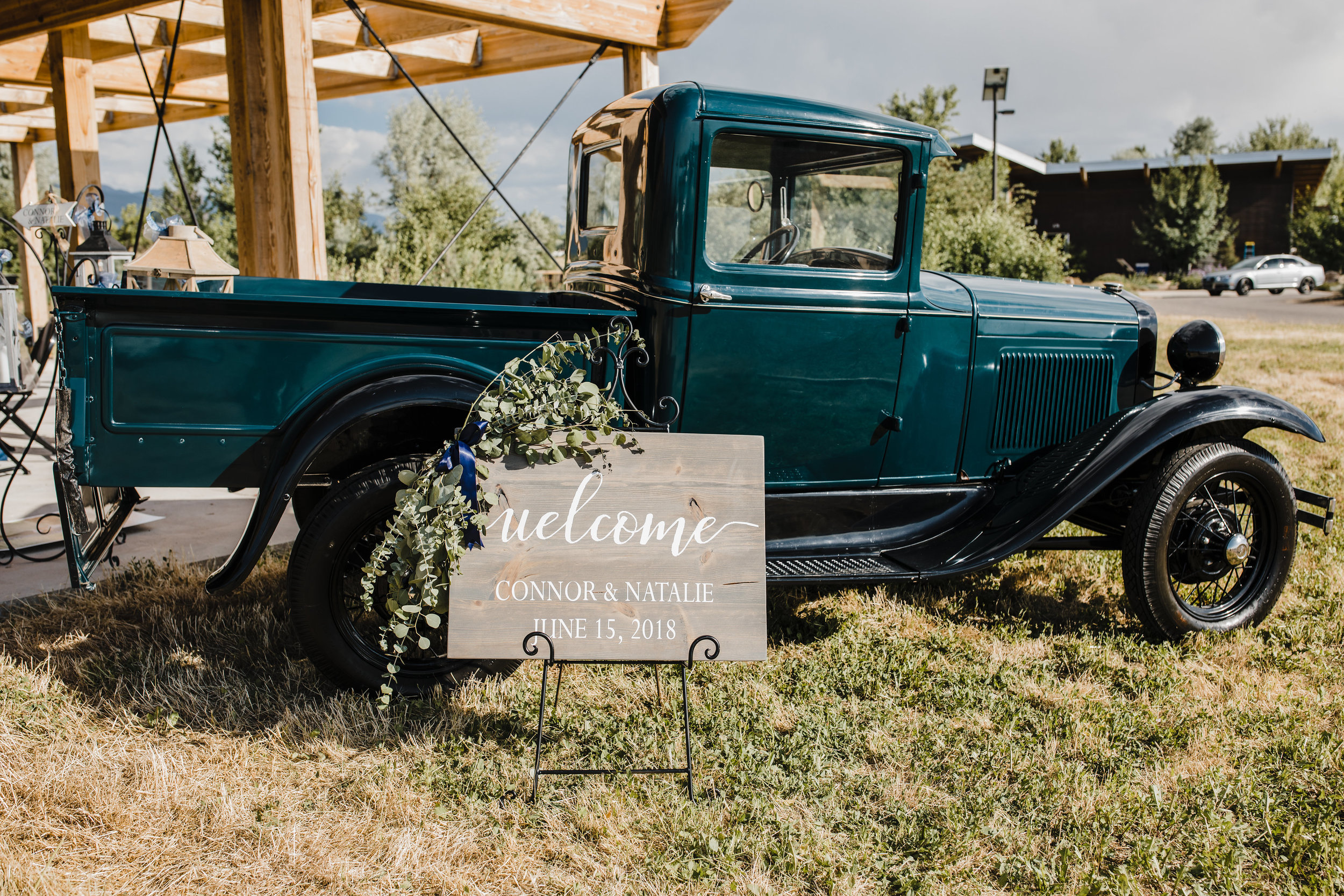 salt lake city professional wedding photographer welcome reception sign rustic vintage car