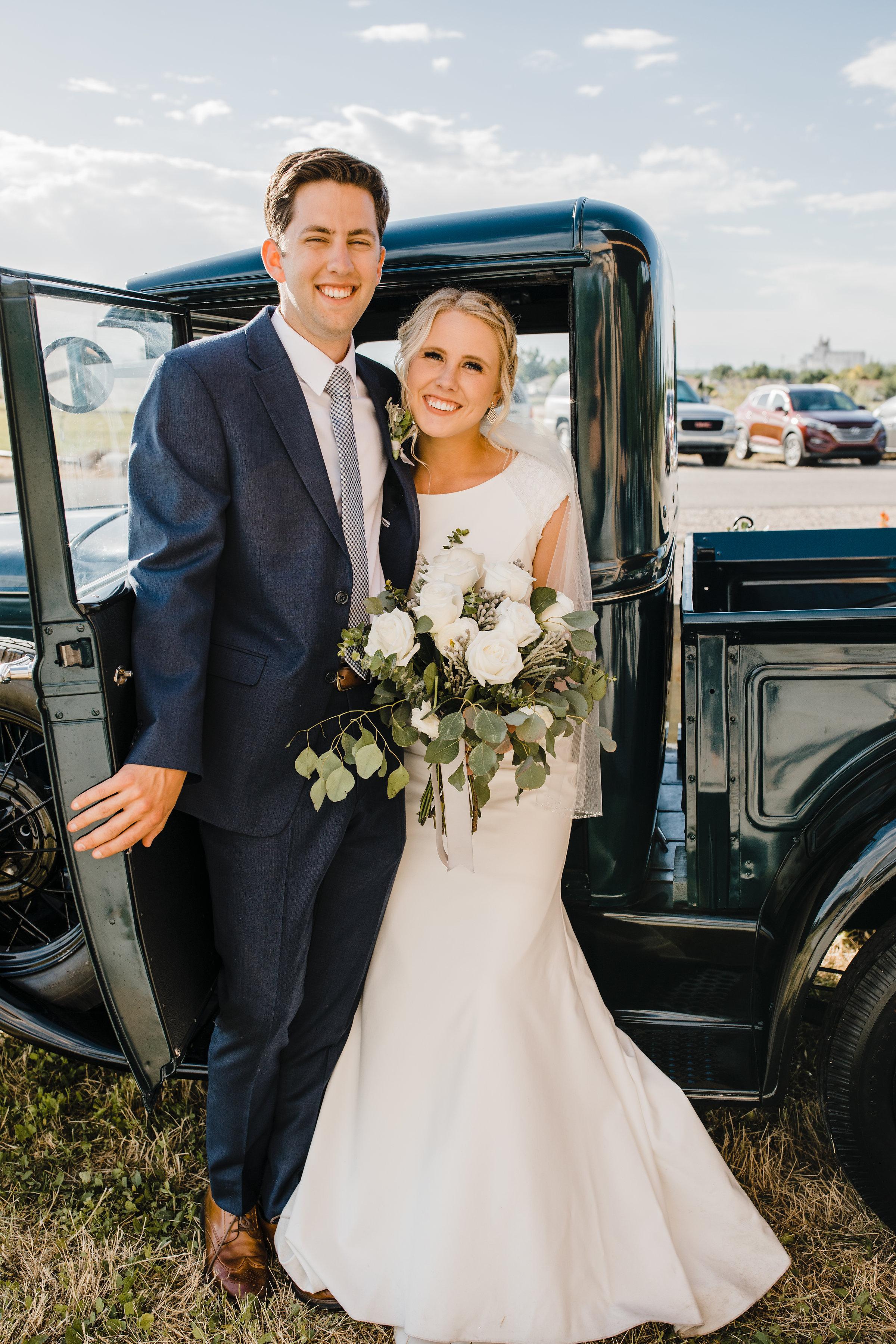 best wedding photographer in utah valley old car gettaway car couple smiling