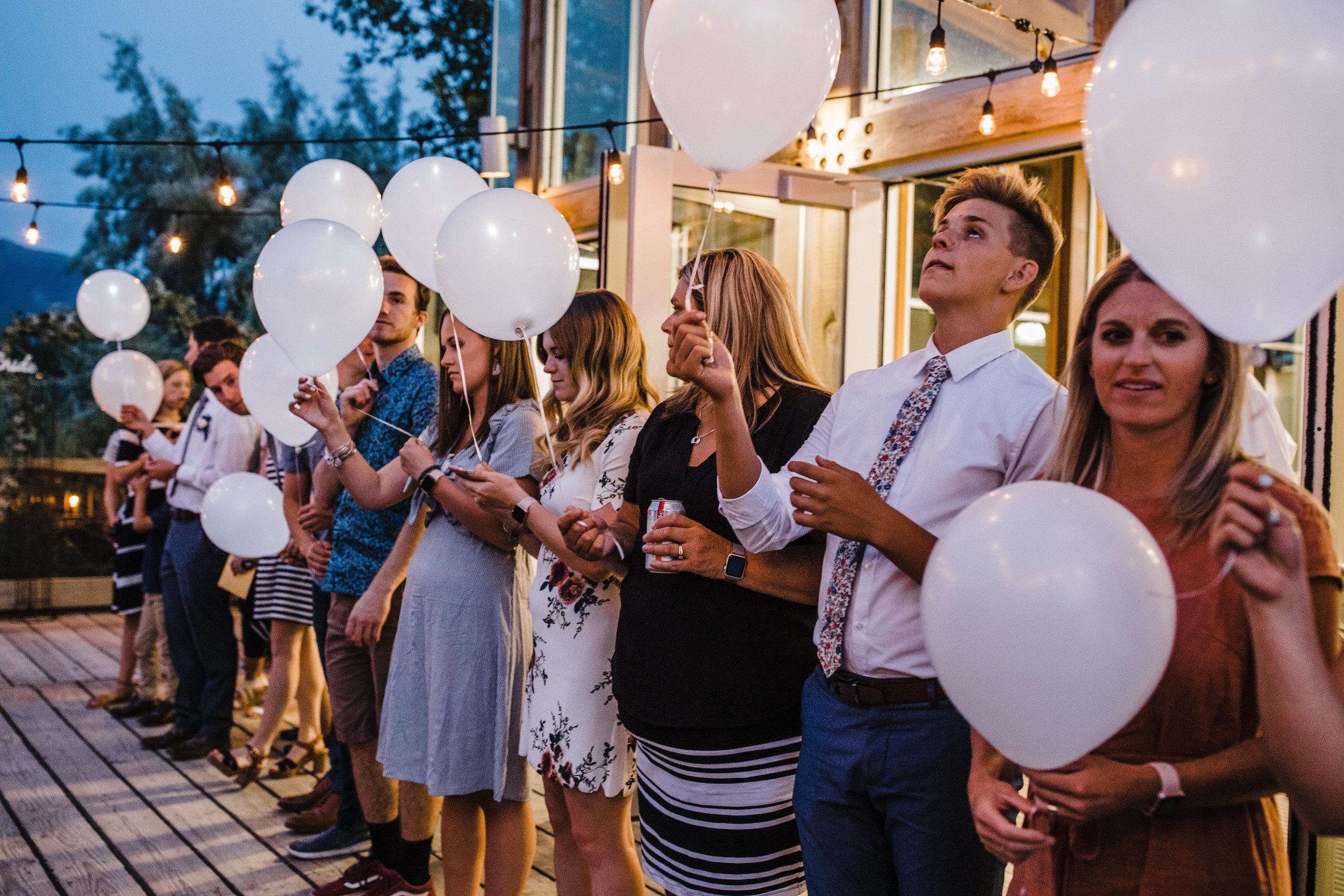best photographer in salt lake white balloong gettaway reception exit