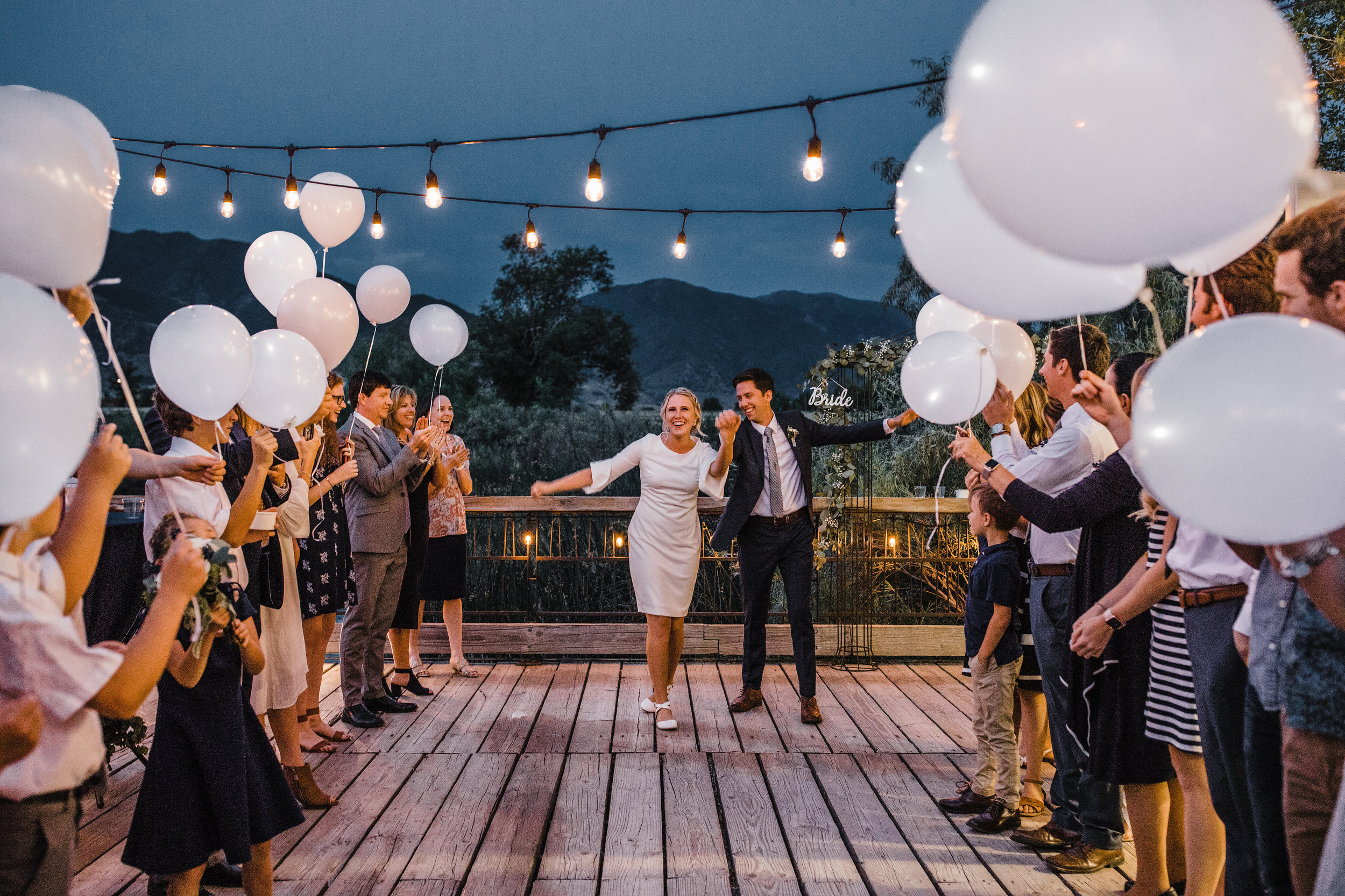 professional wedding photographer in utah valley wedding exit reception white balloon
