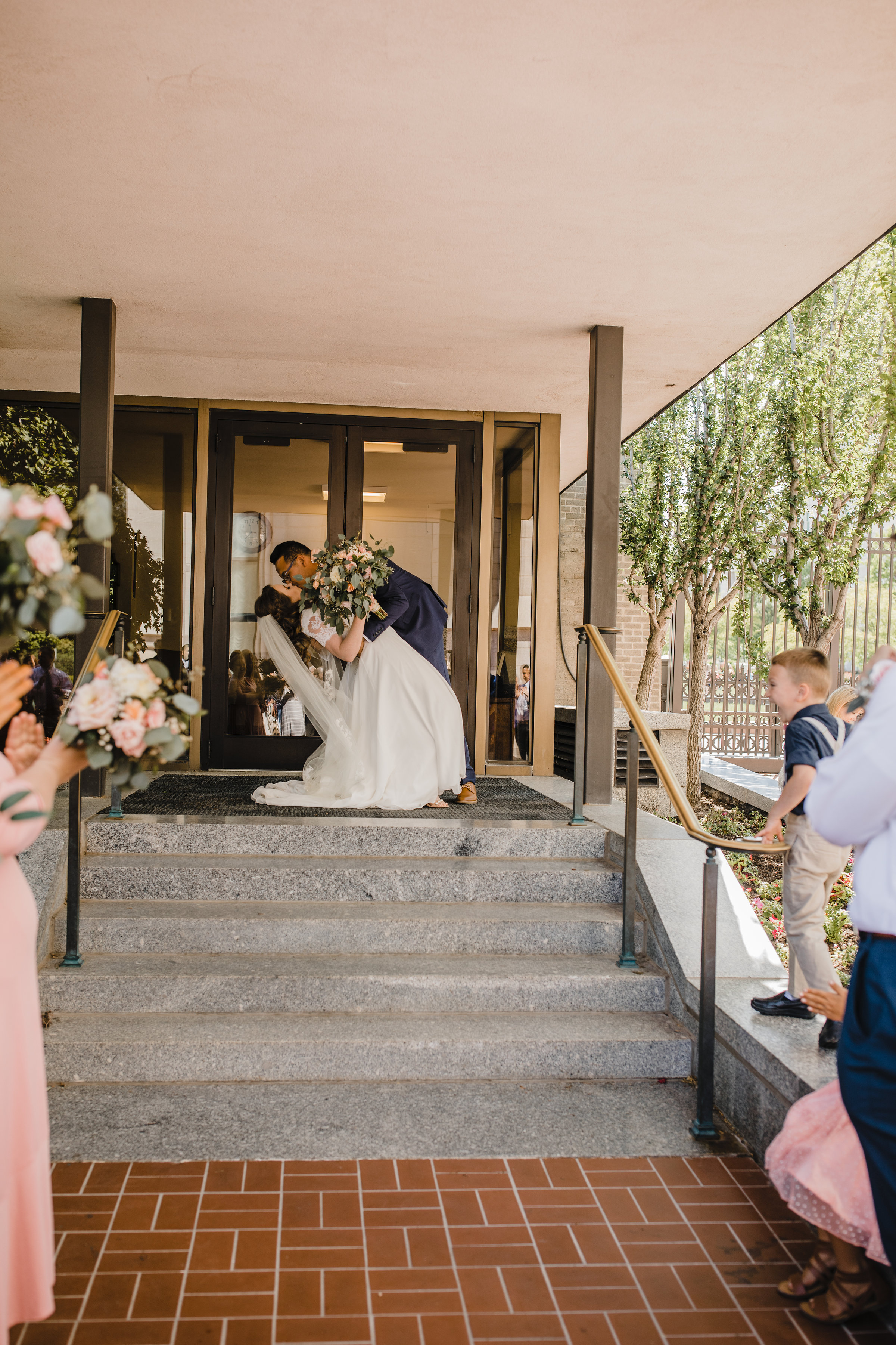 professional photographer in salt lake city utah lds temple exit kissing romantic