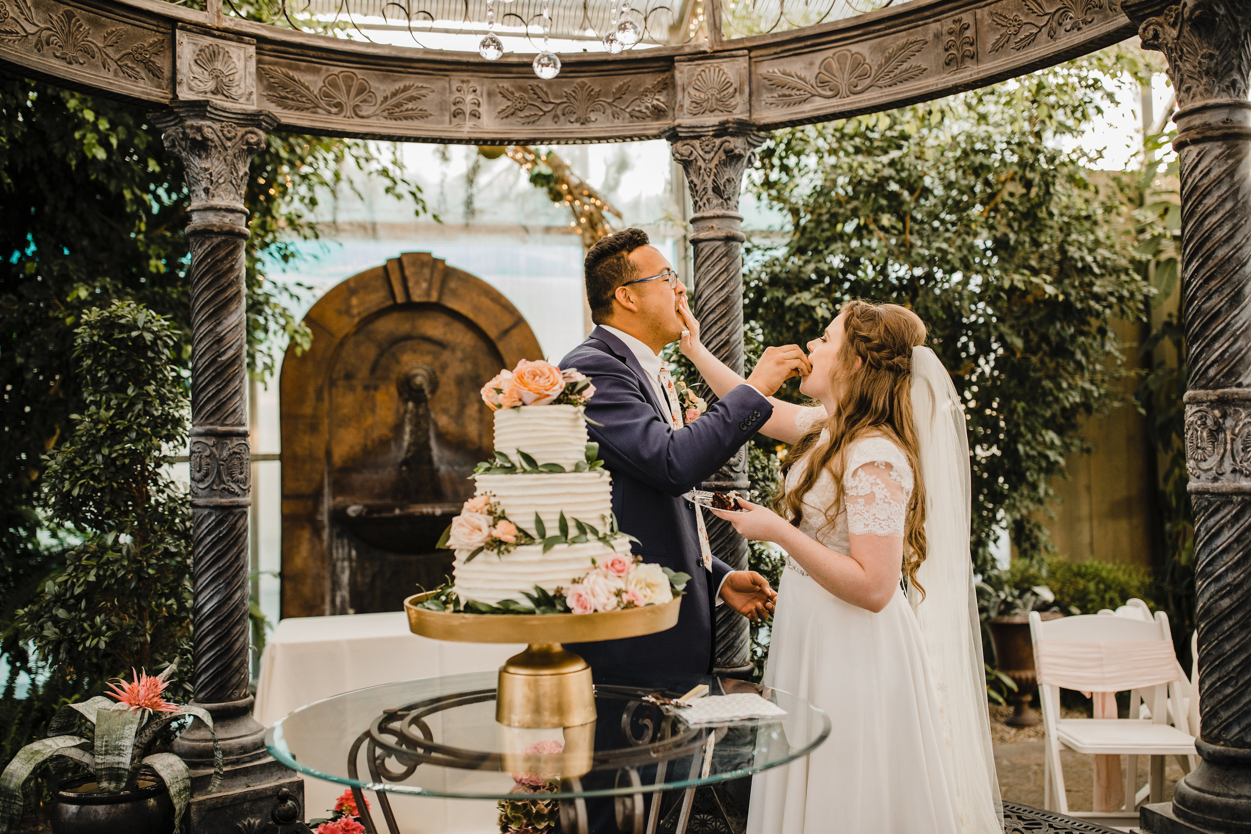 salt lake city wedding photographer reception happy cake feeding blush flowers