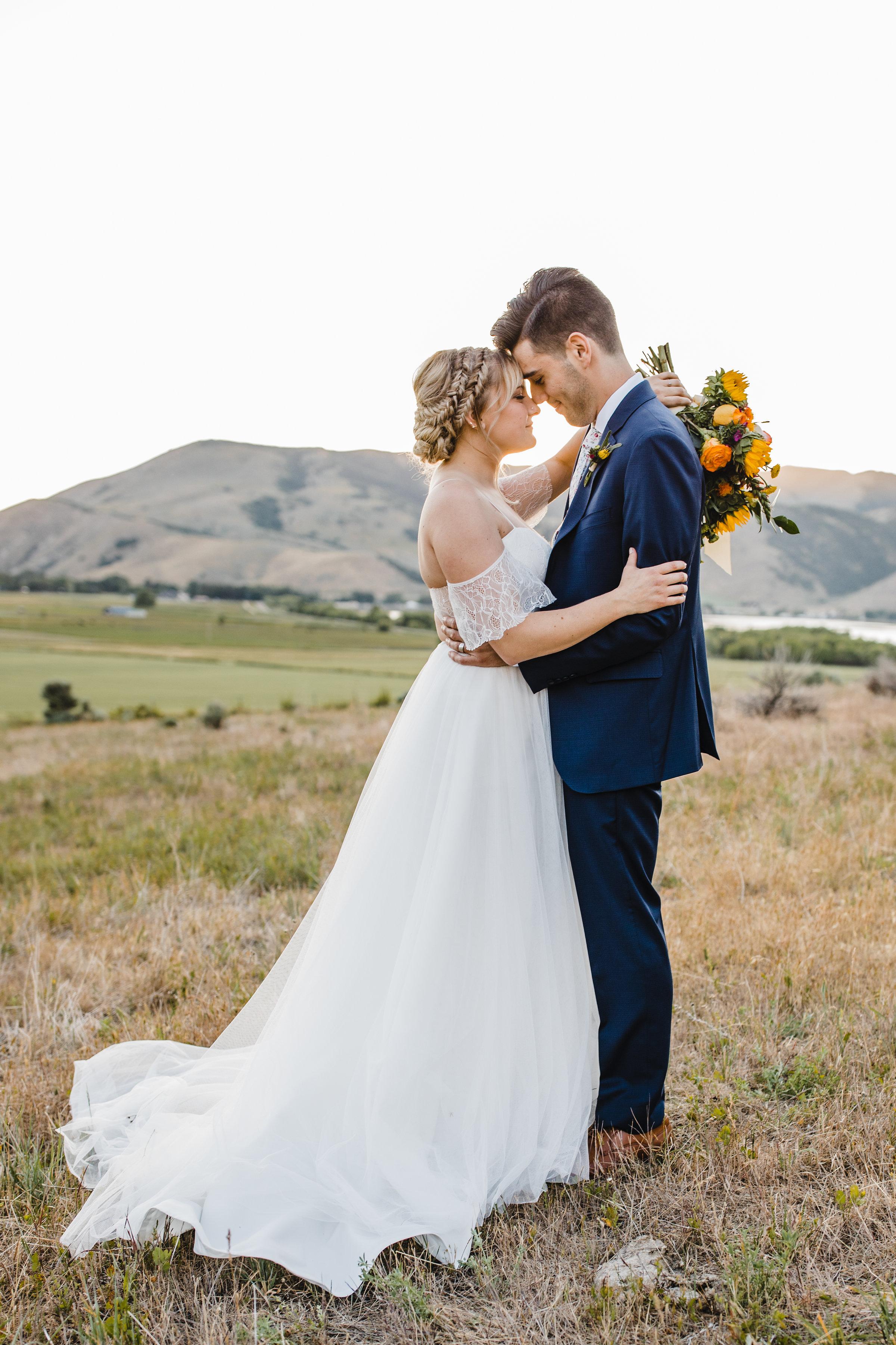 best wedding photographer in cache valley utah logan utah wedding braids bohemian bride dress kissing
