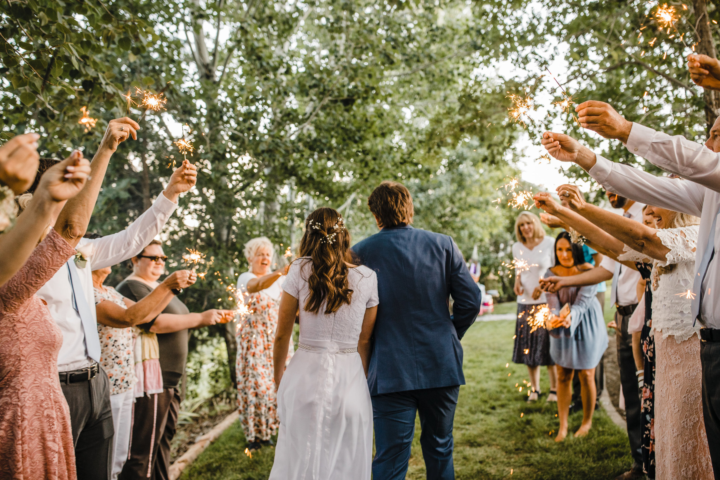 professional wedding photographer cache valley reception exit sparklers outdoor wedding boho wedding hair