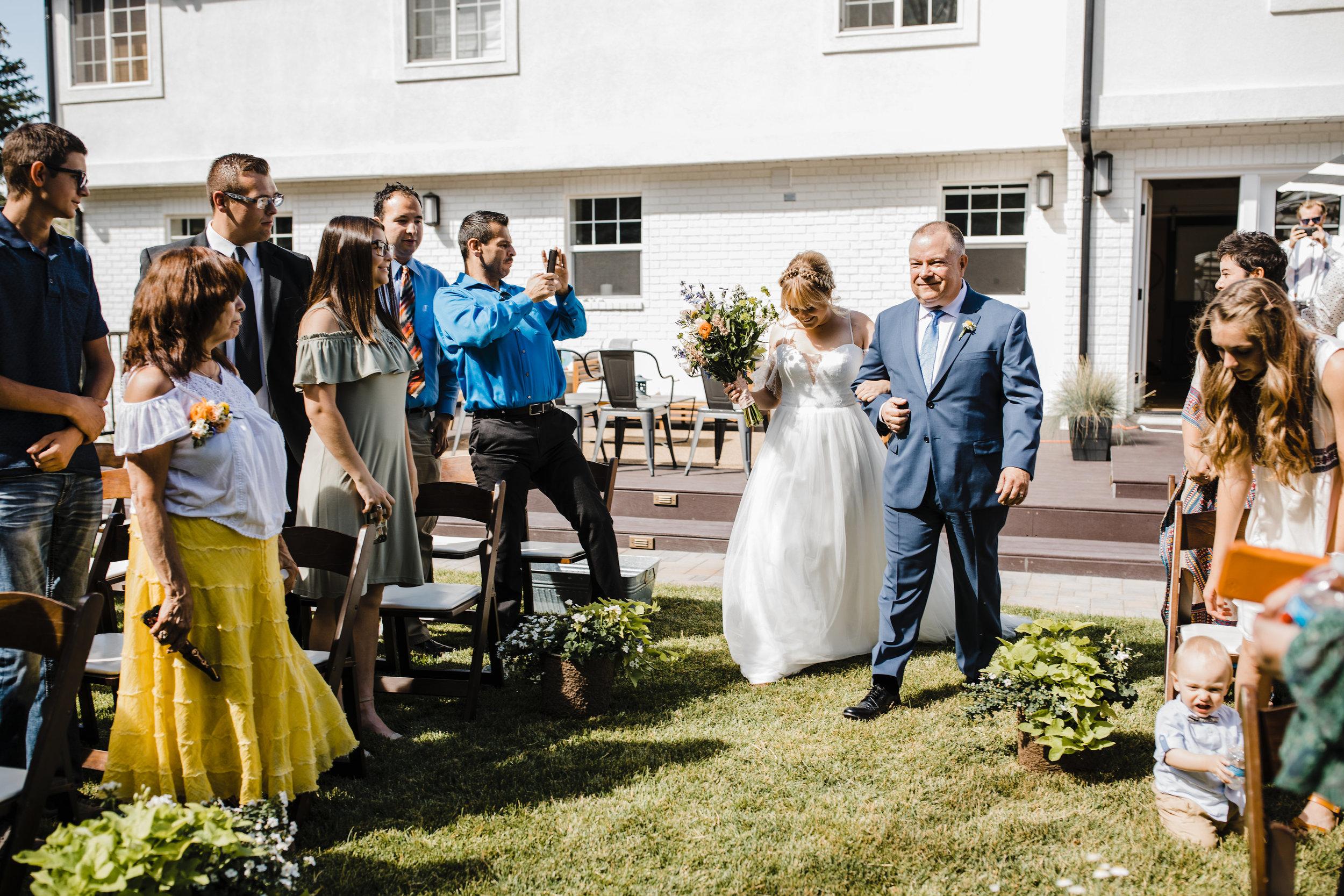 Salt Lake City utah wedding photographer outdoor wedding bohemian chic wedding aisle wildflower bouquet