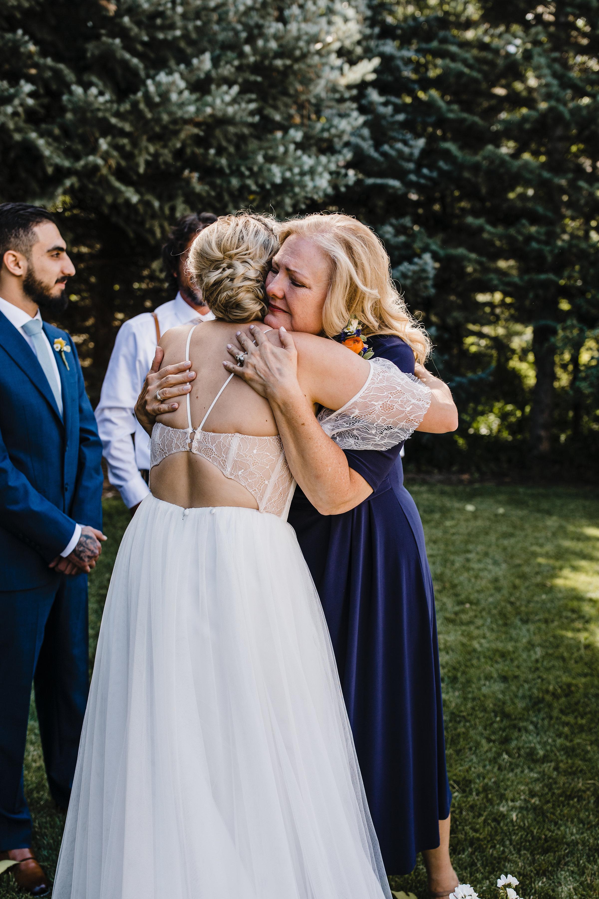 South Jordan Utah photographer outdoor ceremony hugging tears wedding exit