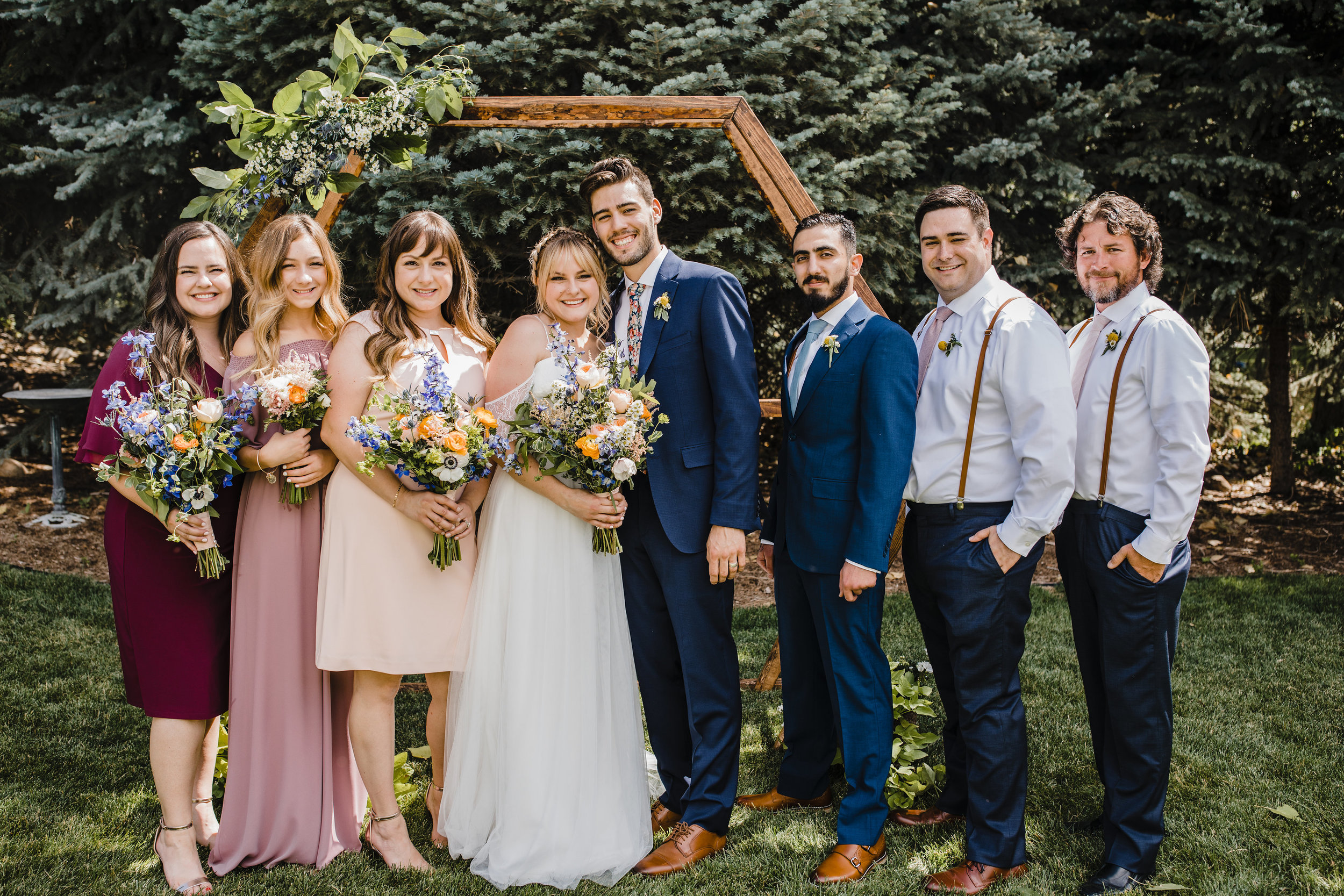 professional wedding photographer in salt lake city utah bohemian outdoor wedding wedding party groomsmen bridesmaids pink red wildflower bouquet