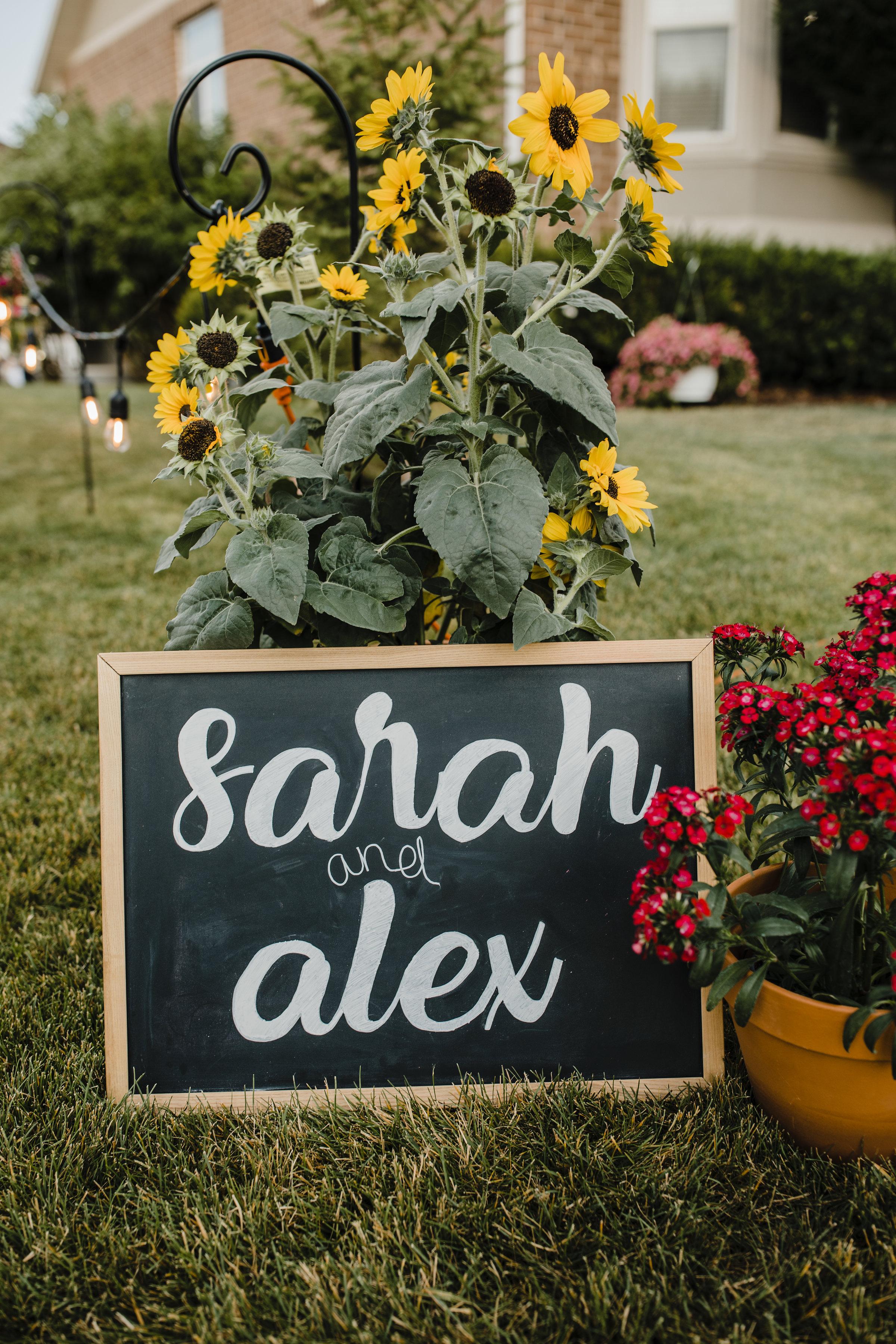 salt lake city wedding photographer outdoor bohemian chic wedding reception welcome sign sunflower