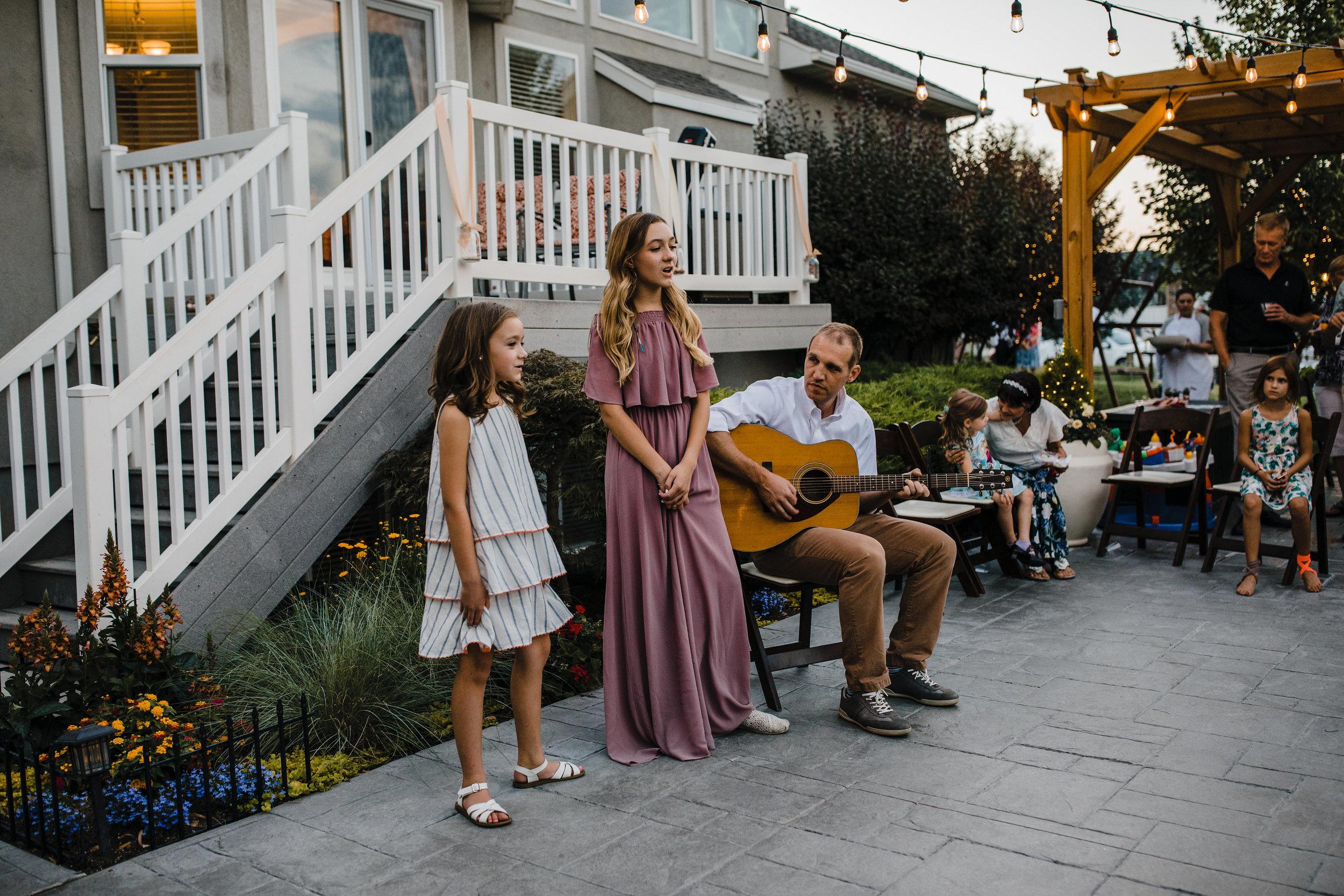 professional wedding photographer in south jordan utah outdoor reception guitar singing string lights