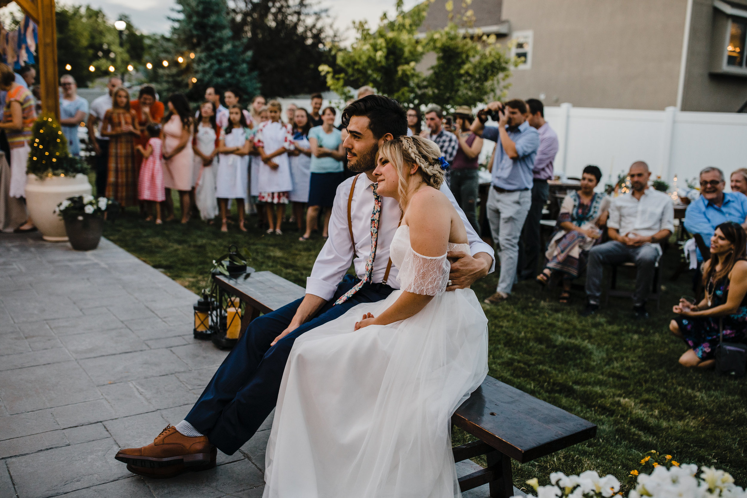 Salt lake city utah professional photographer outdoor reception string lights bride and groom romantic hugging