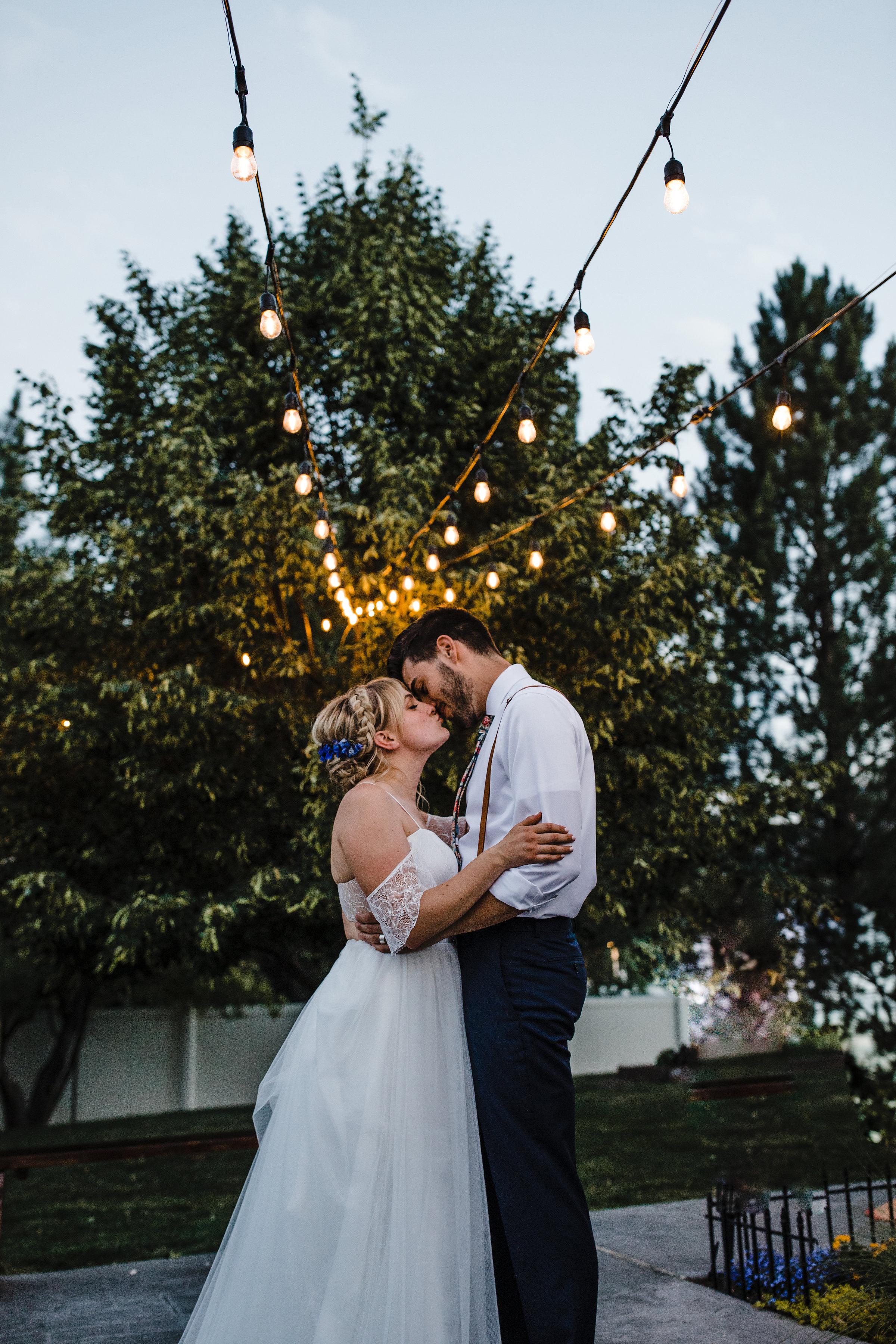 south jordan utah professional photographer first dance outdoor bohemian wedding string lights smiling romantic