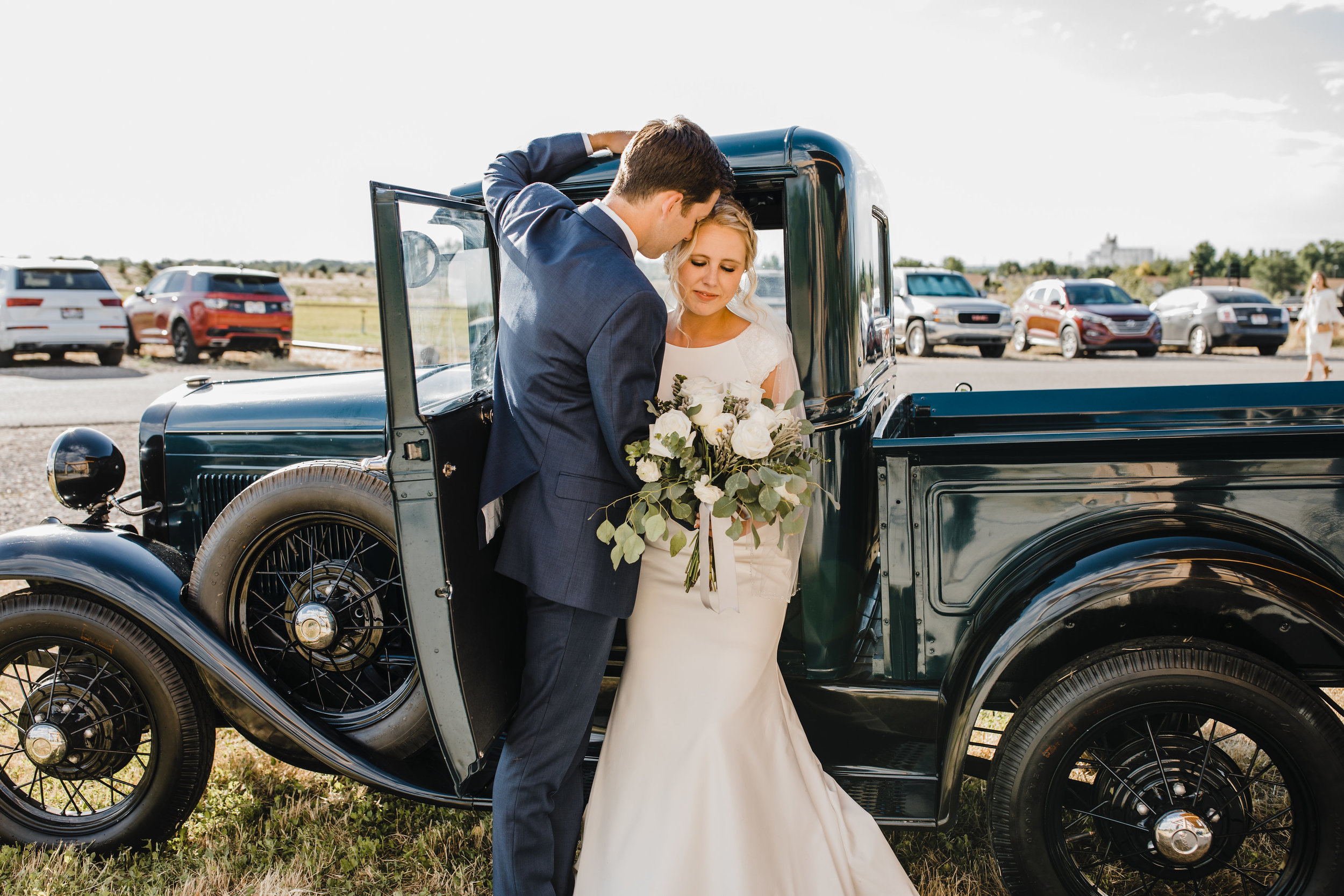 orem utah professional wedding photographer muscle car pickup truck kissing romantic white florals