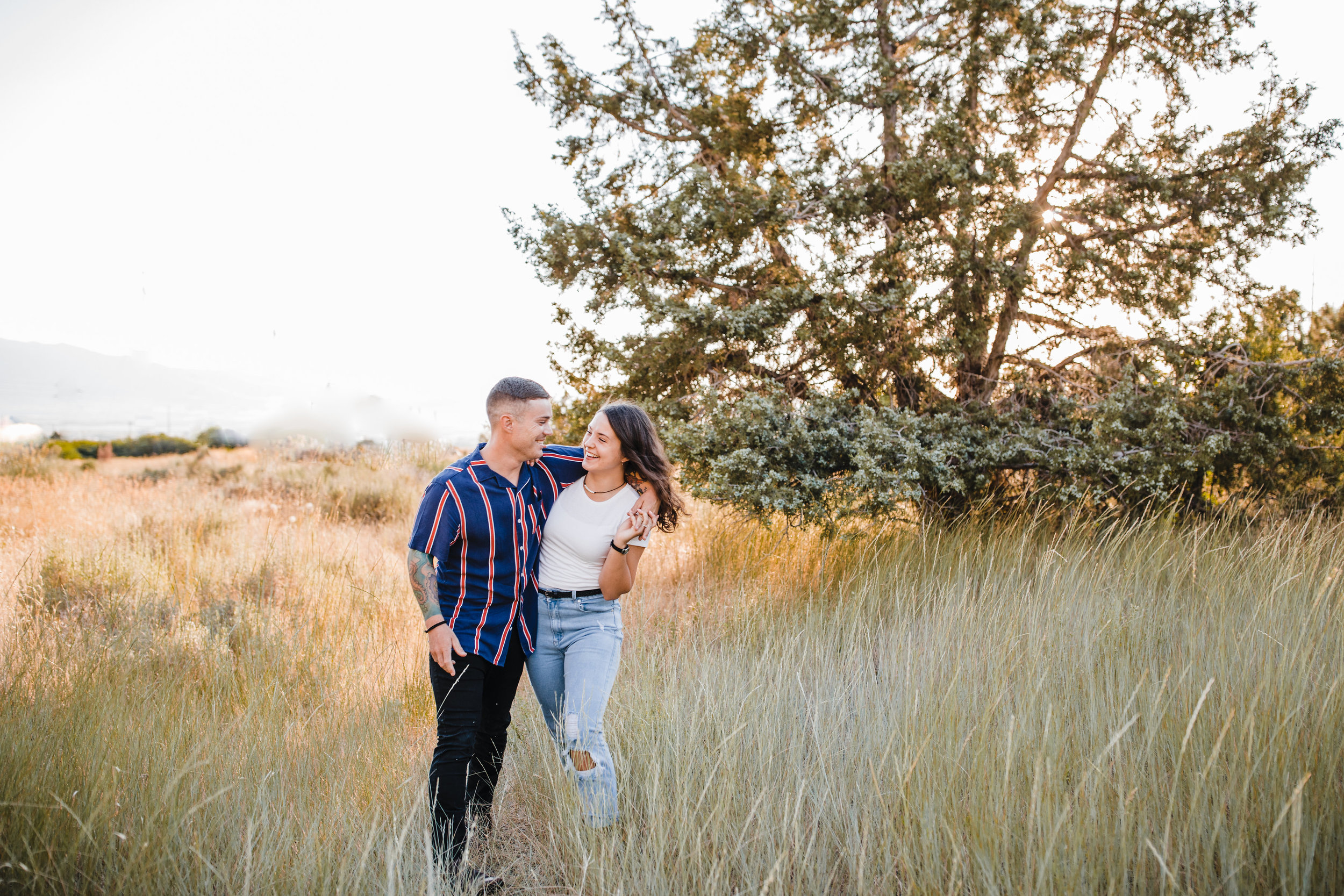 cache valley engagement photographer mountains fields hugging laughing