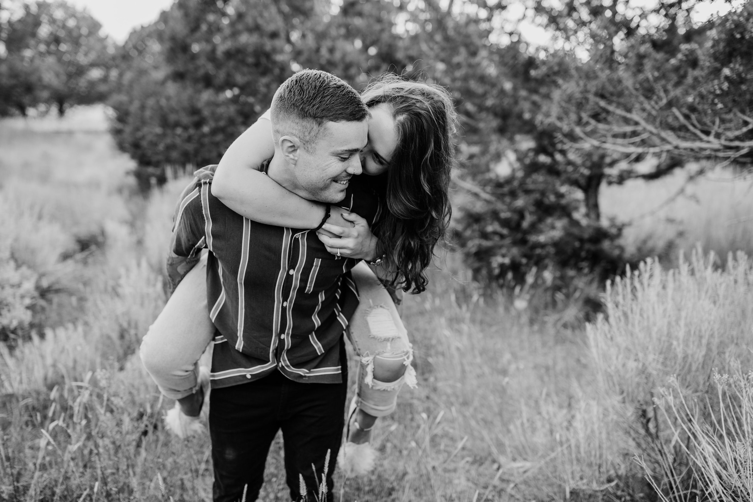 cache valley professional engagement photographer green canyon piggyback ride fields happy hugging